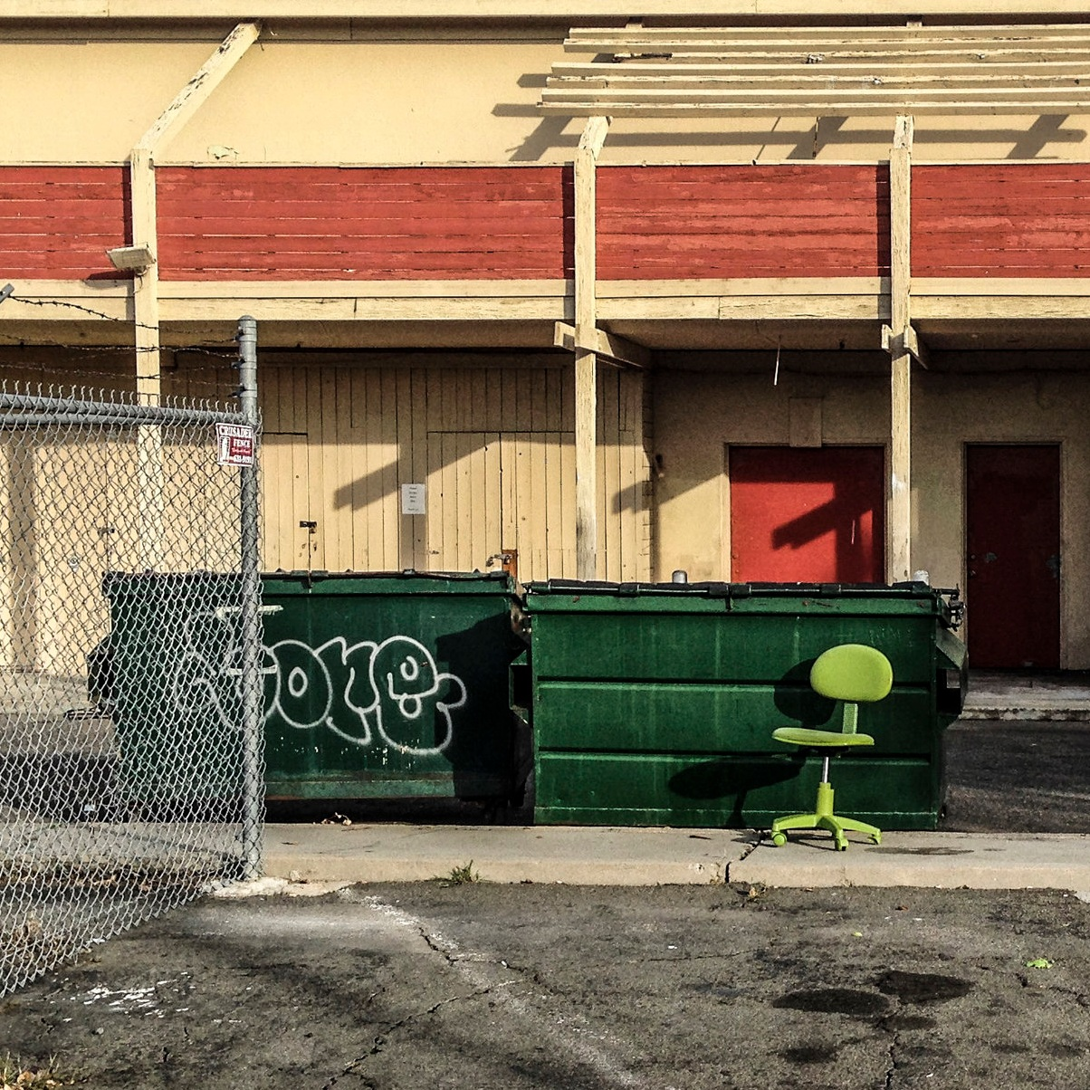 While graffiti on a dumpster is technically not the responsibility of the business, it's unsightly and reflects poorly on the ambiance of the building's exterior.
