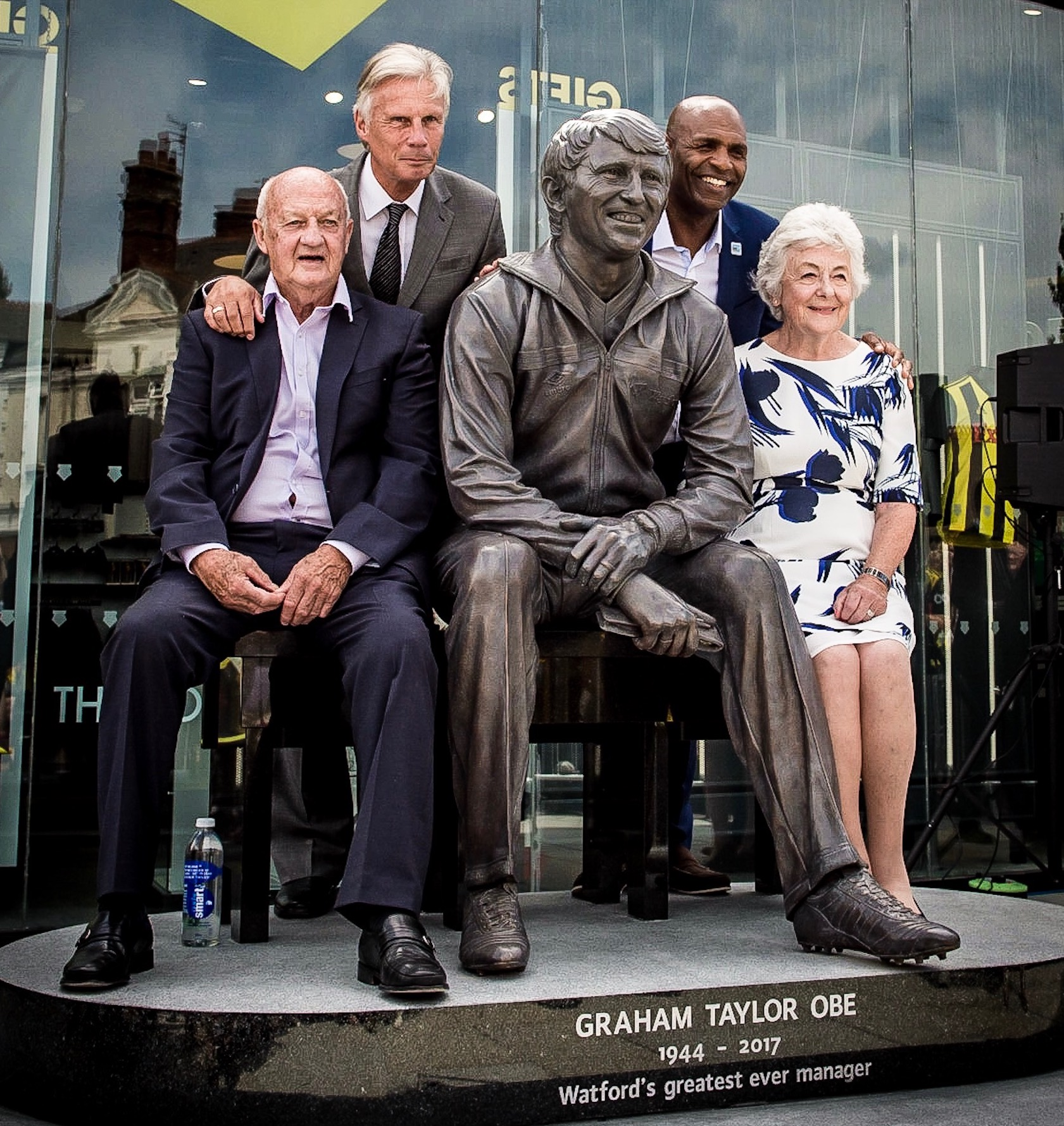 Tom Walley, John Ward, Luther Blissett and Rita Taylor with the statue of Graham Taylor in Vicarage Road. Walley and Blissett were two of the players Graham inherited when he took over at Watford in 1977. Ward, his friend and former team-mate from Lincoln City, came a little later. Photograph by Simon Gill.