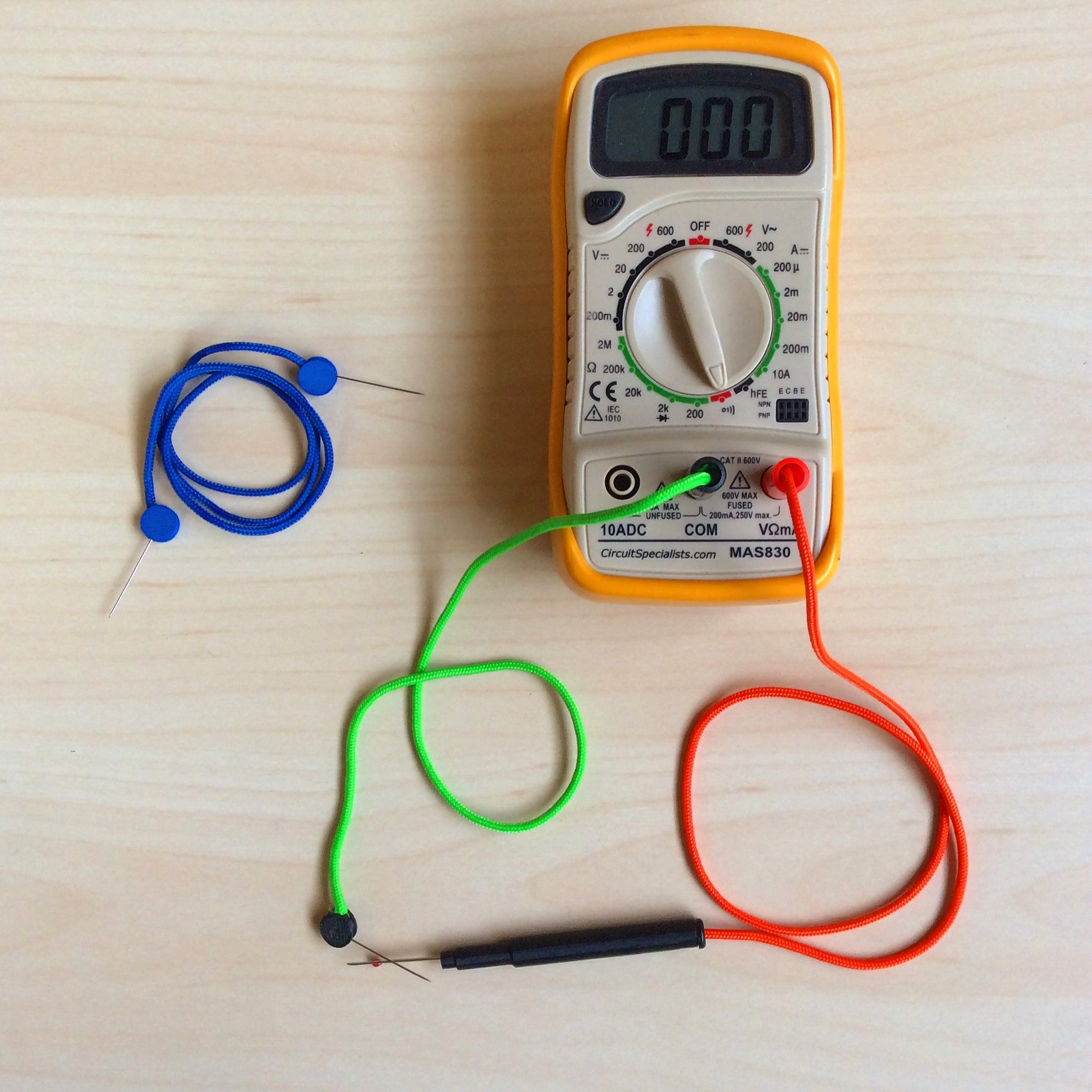 E-textile tools made at Irene's workshop: blue pin probes (to replace alligator clips), green multimeter pin probe and orange multimeter seam ripper probe for testing.