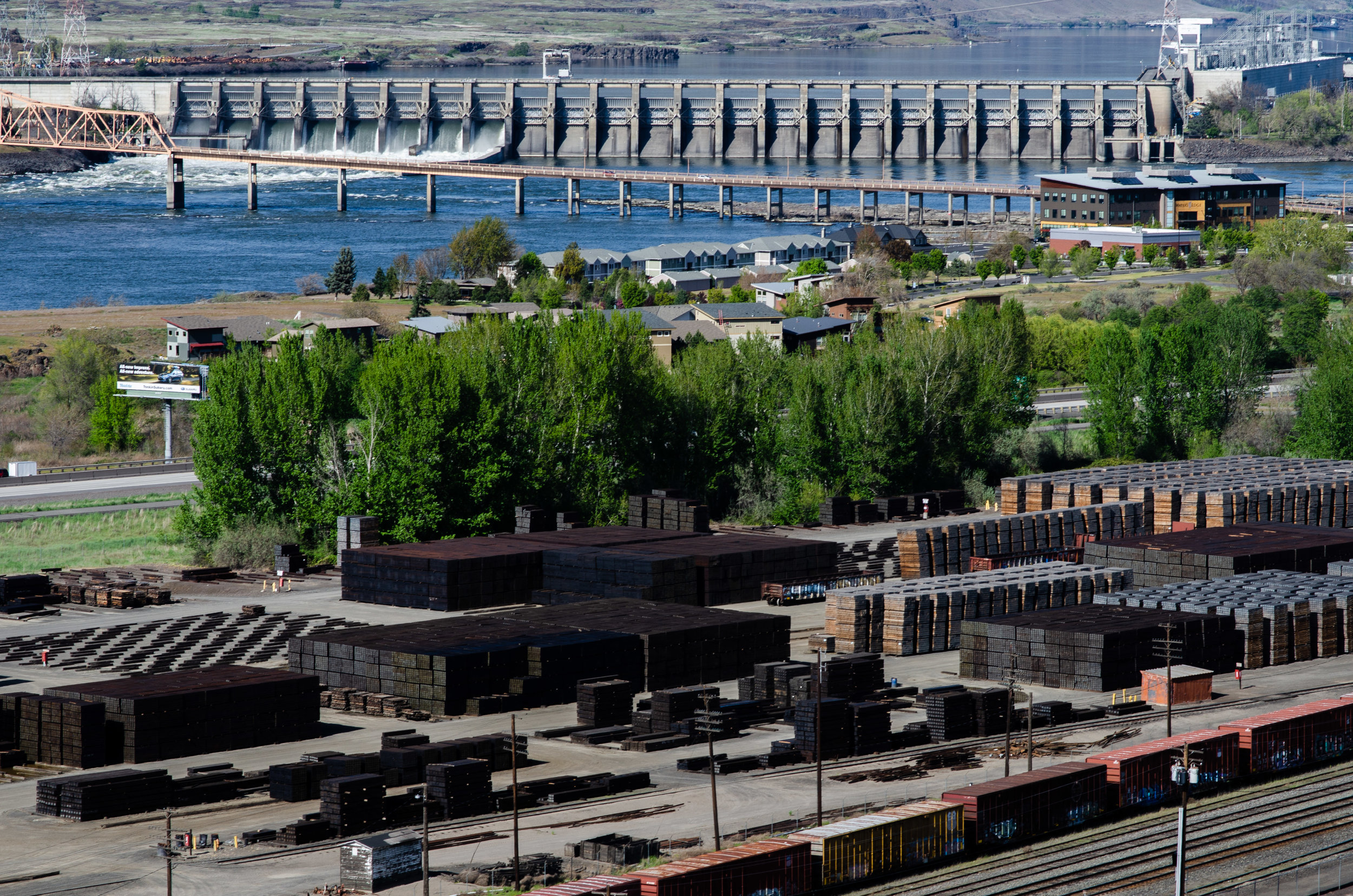 Railroad cross-ties treated with creosote are stored at the AmeriTies West plant as the Columbia River spills over The Dalles Dam.
