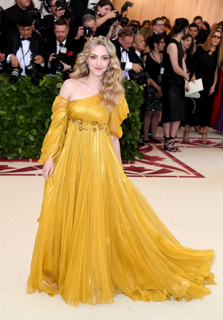 Amanda Seyfried,  wearing Prada  She looks like an ethereal, Shakespearean goddess. When she arrived the wind hit her soft curls and her flowy dress in a very dramatic way - it was a moment.