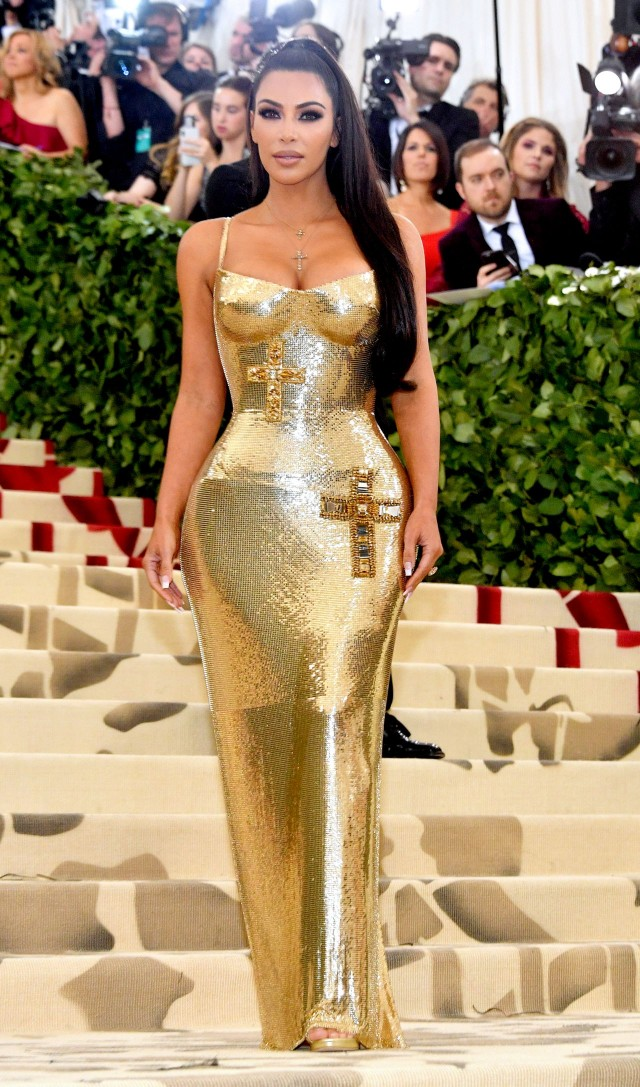 Kim Kardashian West , wearing Versace  I love Kim K. Always have, always will. She looks amazing in this. Her body is perfect and her makeup and hair couldn't be better. I'm very impressed.