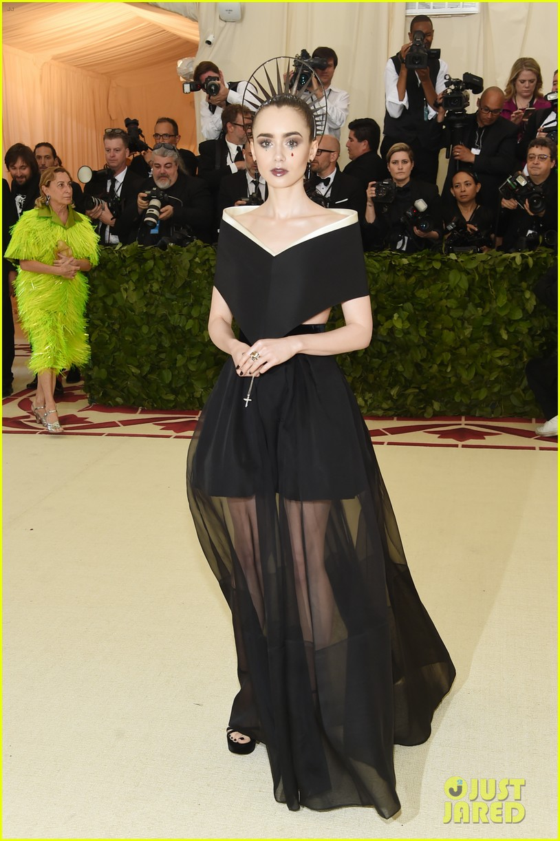 Lily Collins , wearing Givenchy Haute Couture  I tend to always like what Lily Collins shows up to events and award shows in. This is no exception. It's very naughty nun, and I'm feeling it.