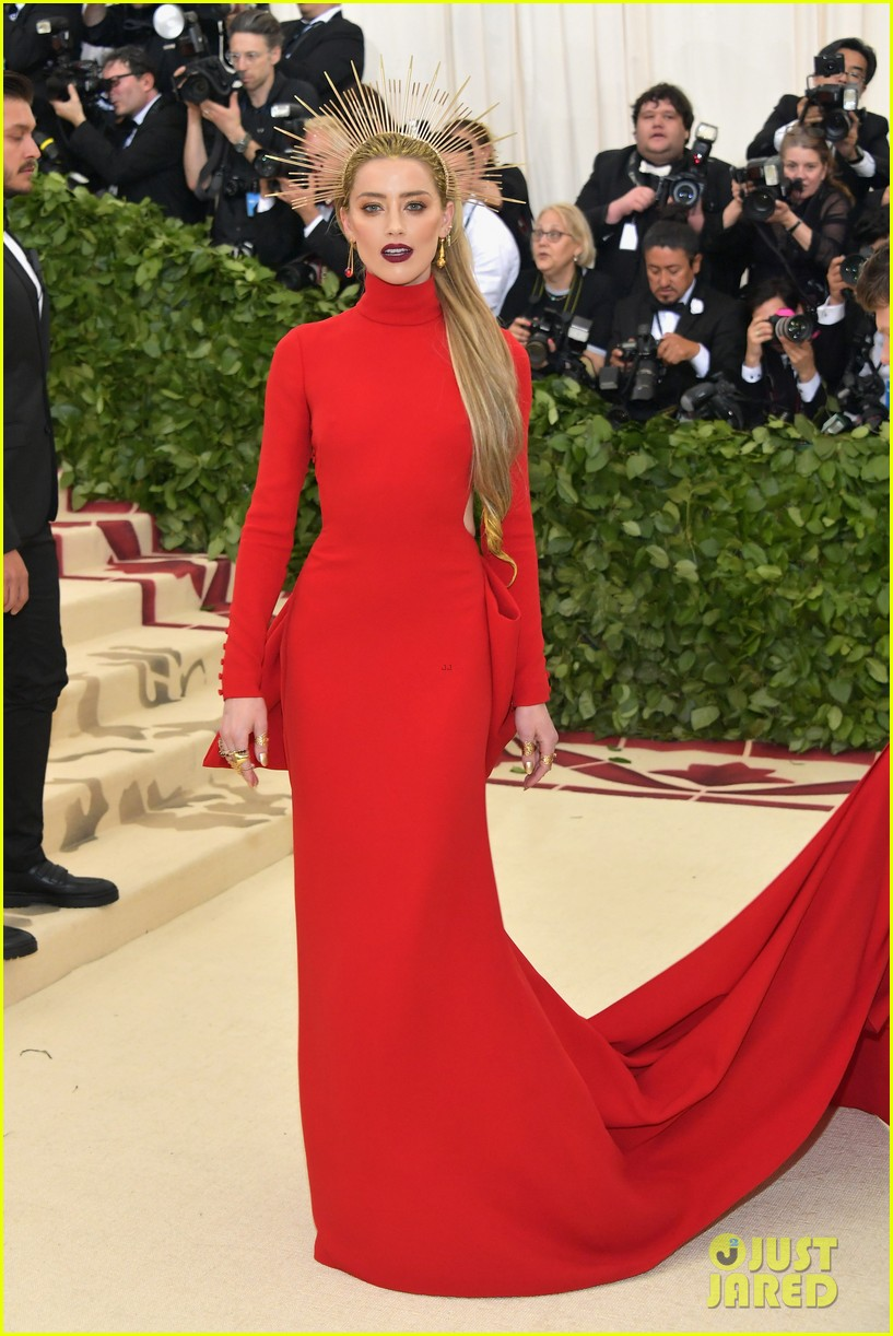Amber Heard , wearing Carolina Herrera  This dress is hot, and her headpiece is on point (literally).