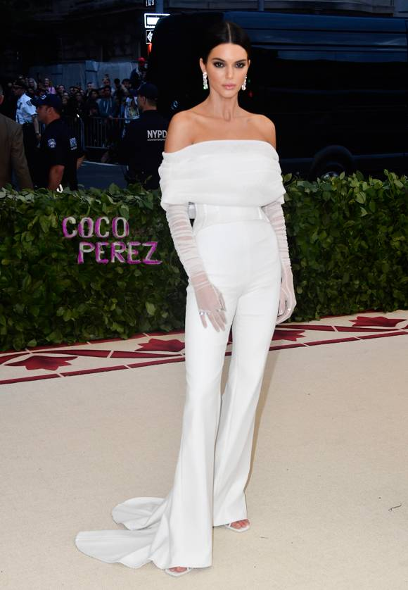 Kendall Jenner , wearing Virgil Abloh  This jumpsuit doesn't SCREAM the theme, but it's so pretty. The gloves are such a beautiful, feminine touch.