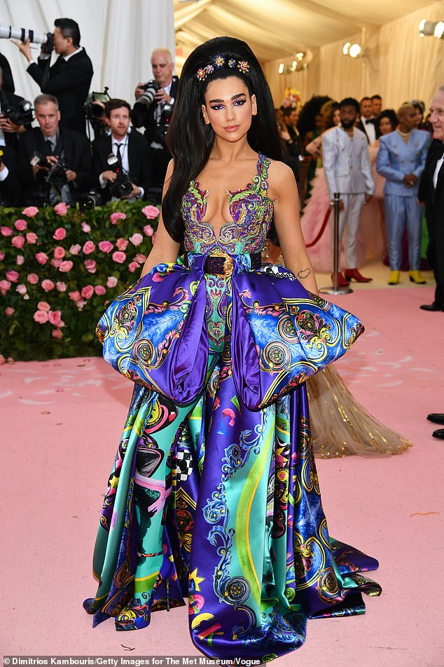 Dua-Lipa-makes-Met-Gala-debut-in-immersing-a-Versace-dress-next-to-friend-Isaac-Carew.jpg