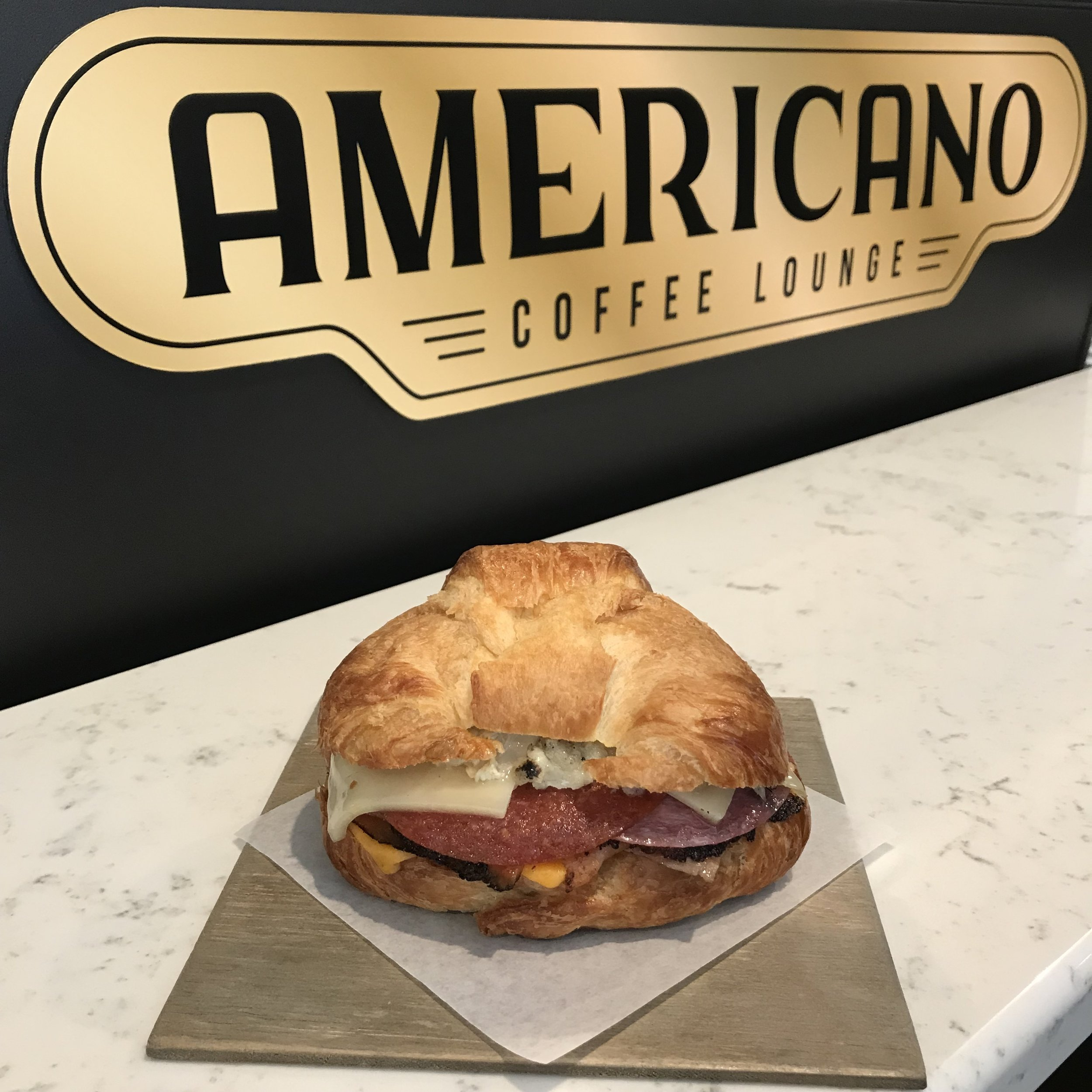 Croissant Sandwich in front of espresso machine at Americano Coffee Lounge 434 Houston Street Suite 120 Nashville Tennessee 37203