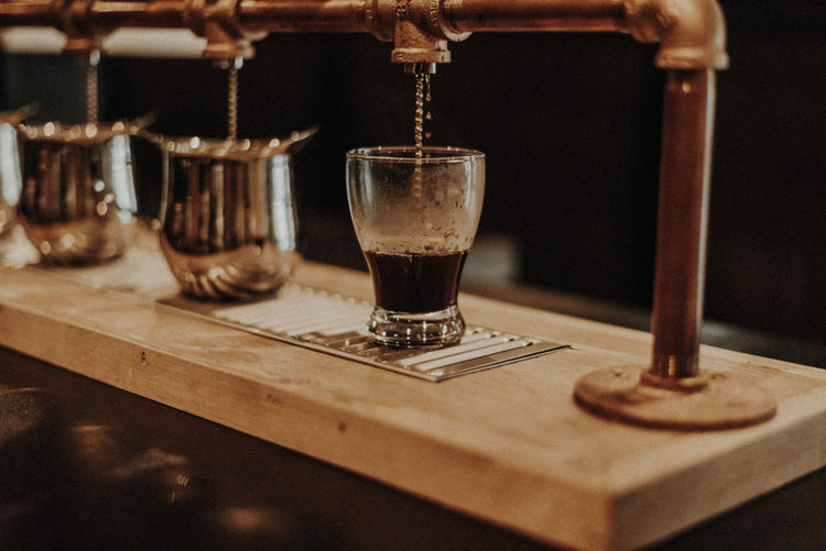 Brass Pour Over Station at Americano Coffee Lounge 434 Houston Street Suite 120 Nashville Tennessee 37203 serving Estate Single Origin AA Coffee.