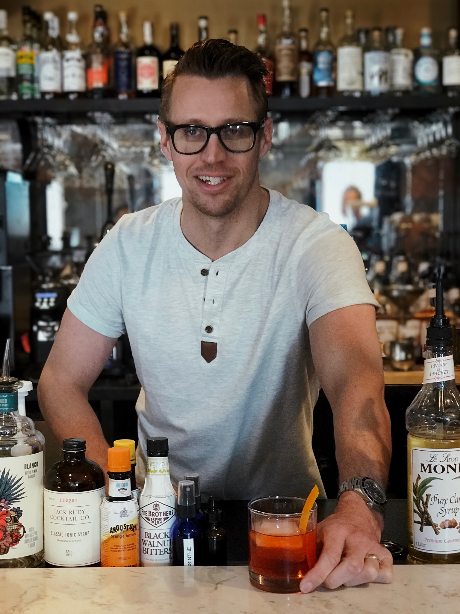 Owner and founder Cody Pellerin serving up his favorite cocktail, Plantation OFTD Negroni.