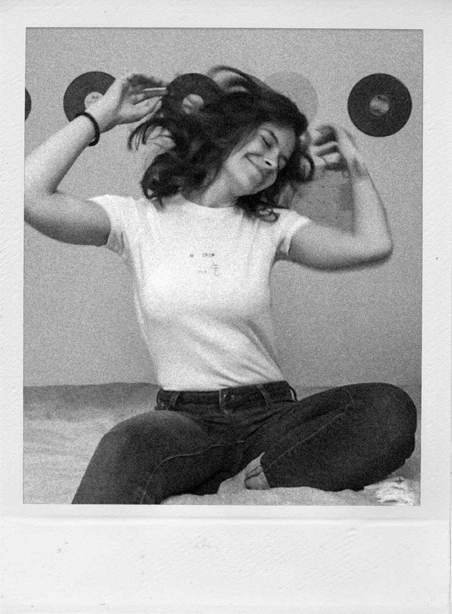 FaceTime photoshoot of a woman in her bedroom and records behind her shaking hair.
