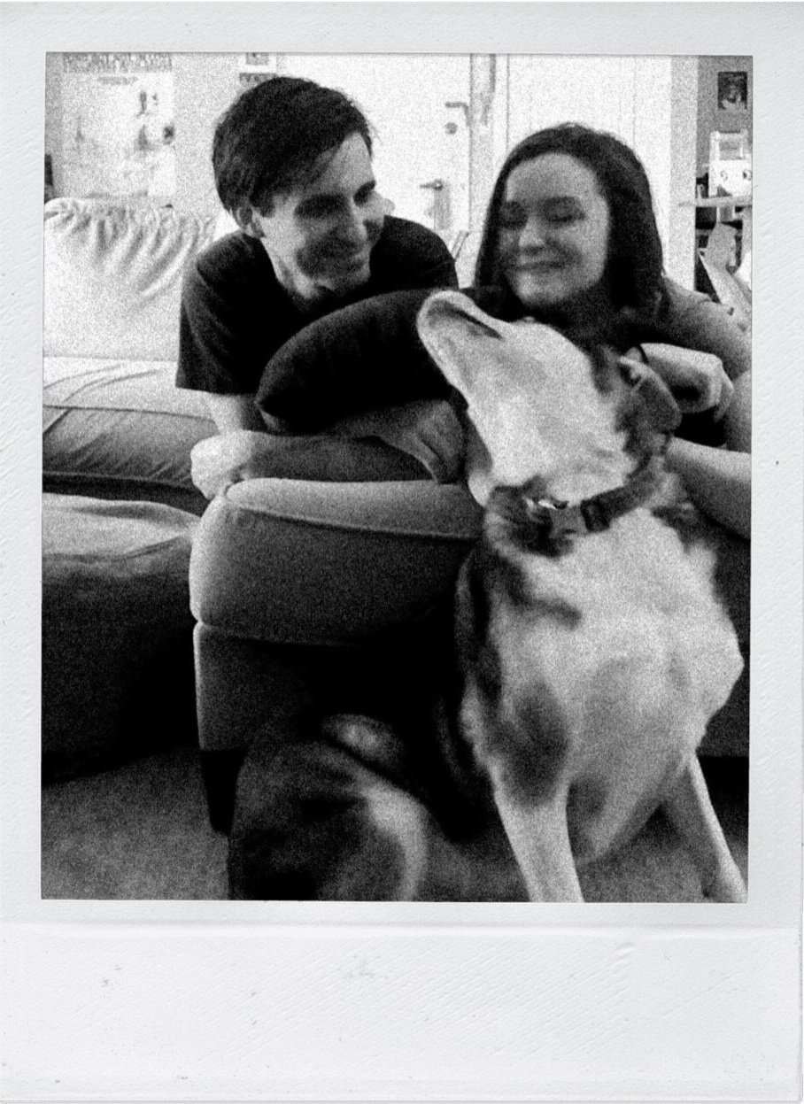 Couple with a dog in their home taken via FaceTime