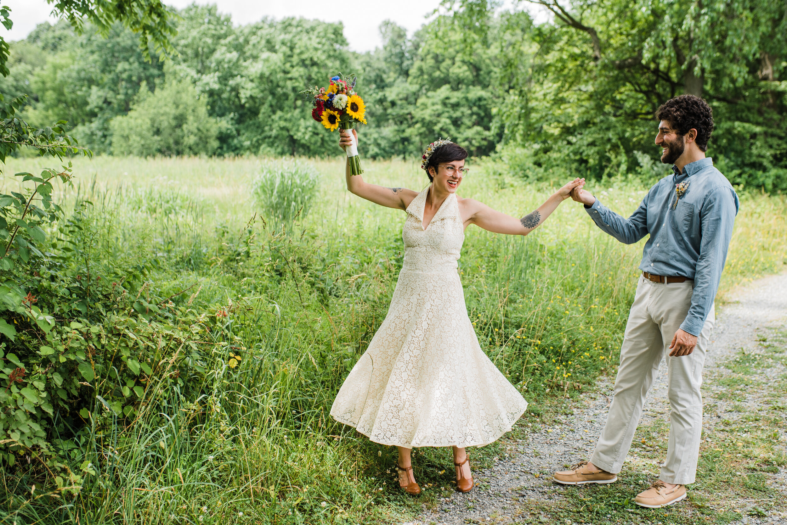 Vintage inspired wedding couple dancing in an open field