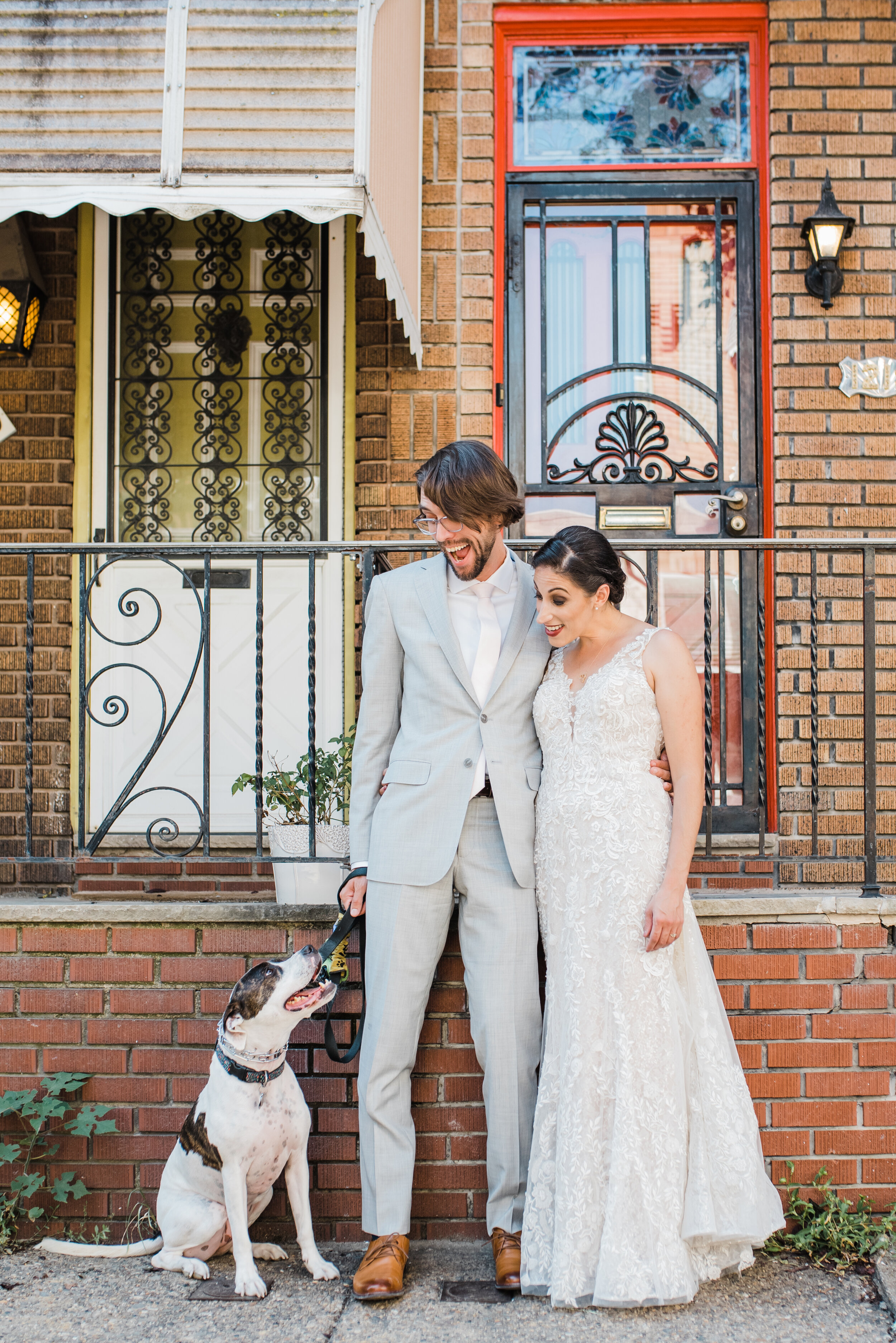 Wedding couple with their dog at their home.