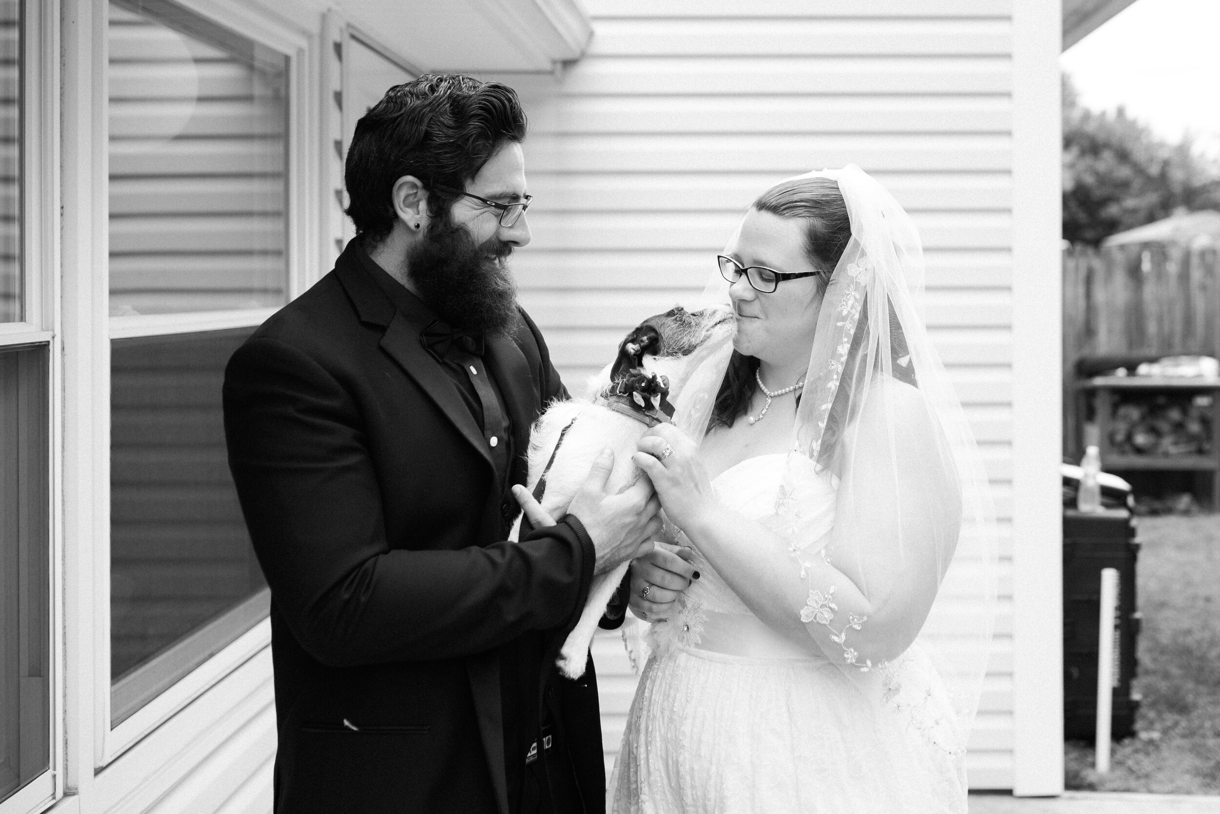 Wedding couple with their dog after the ceremony.