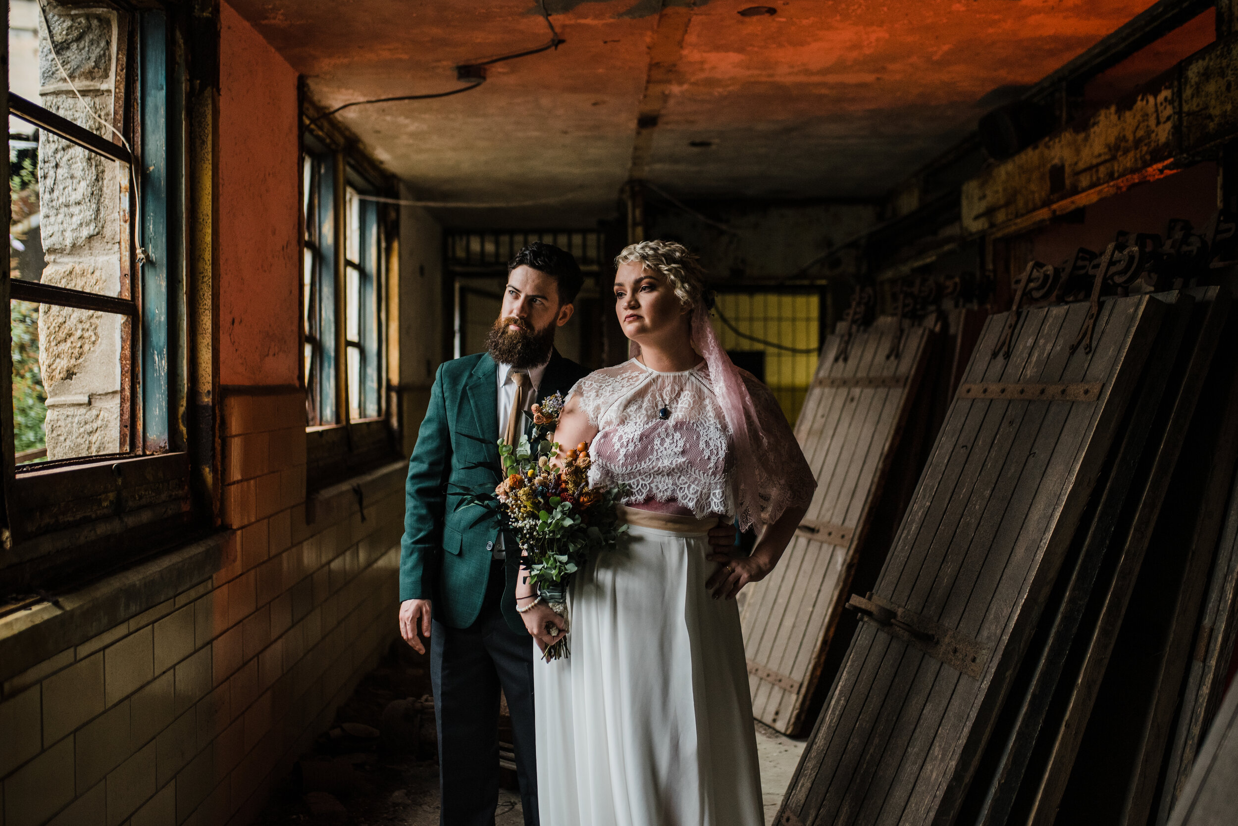Wedding couple in a distressed building.