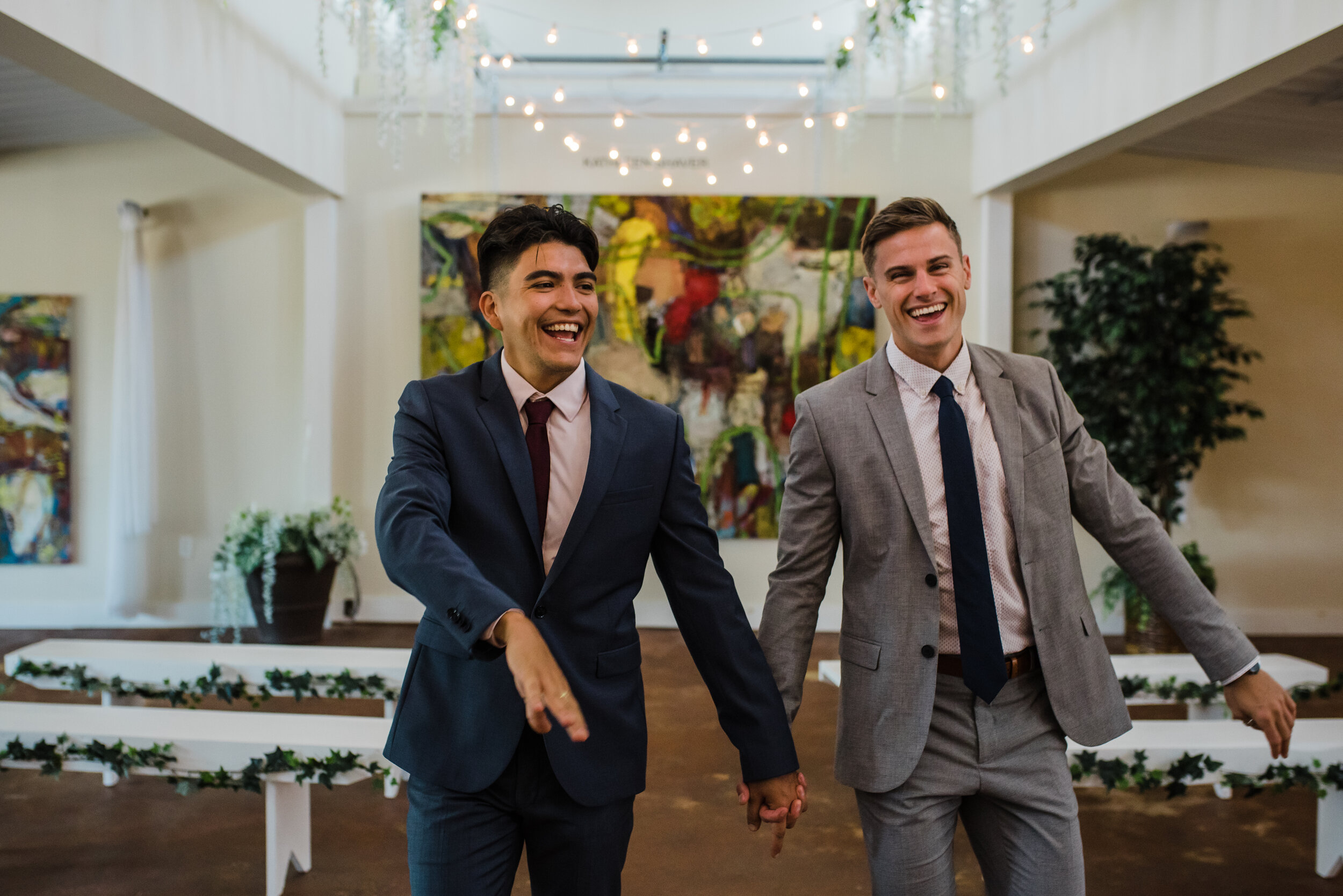 LGBTQ couple walking down the aisle after the ceremony.
