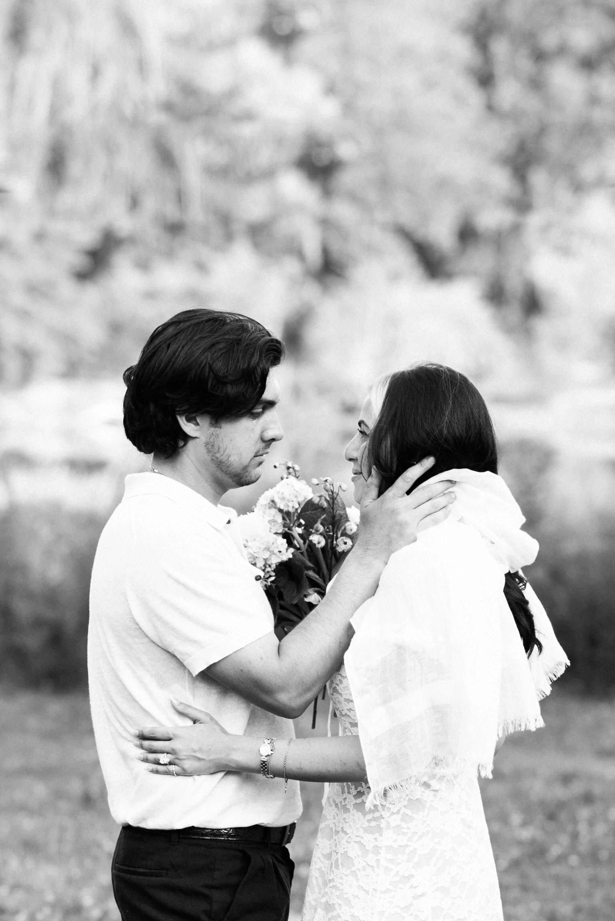 Emotional vow exchange between a wedding couple.