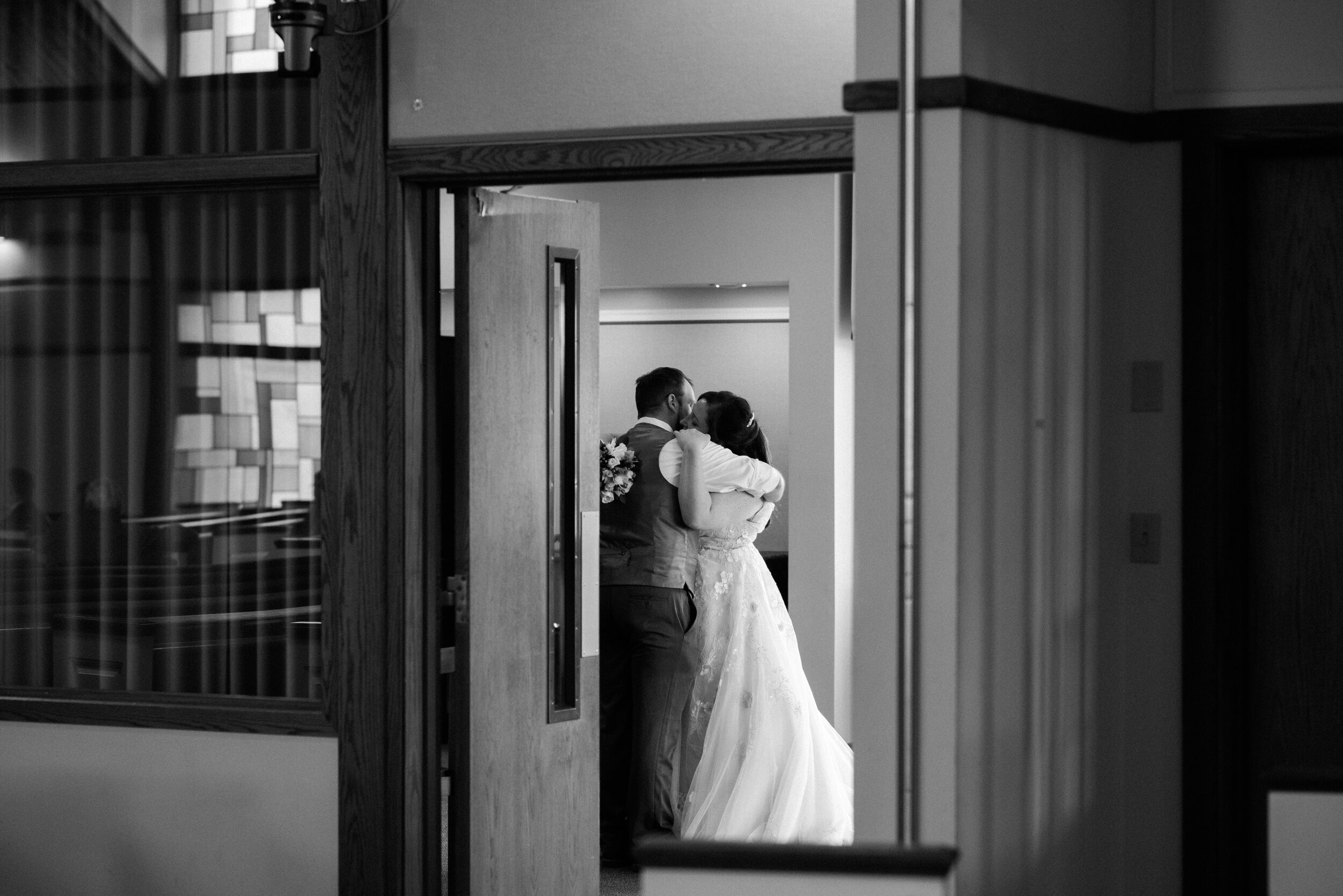 Wedding couple embracing after their ceremony.