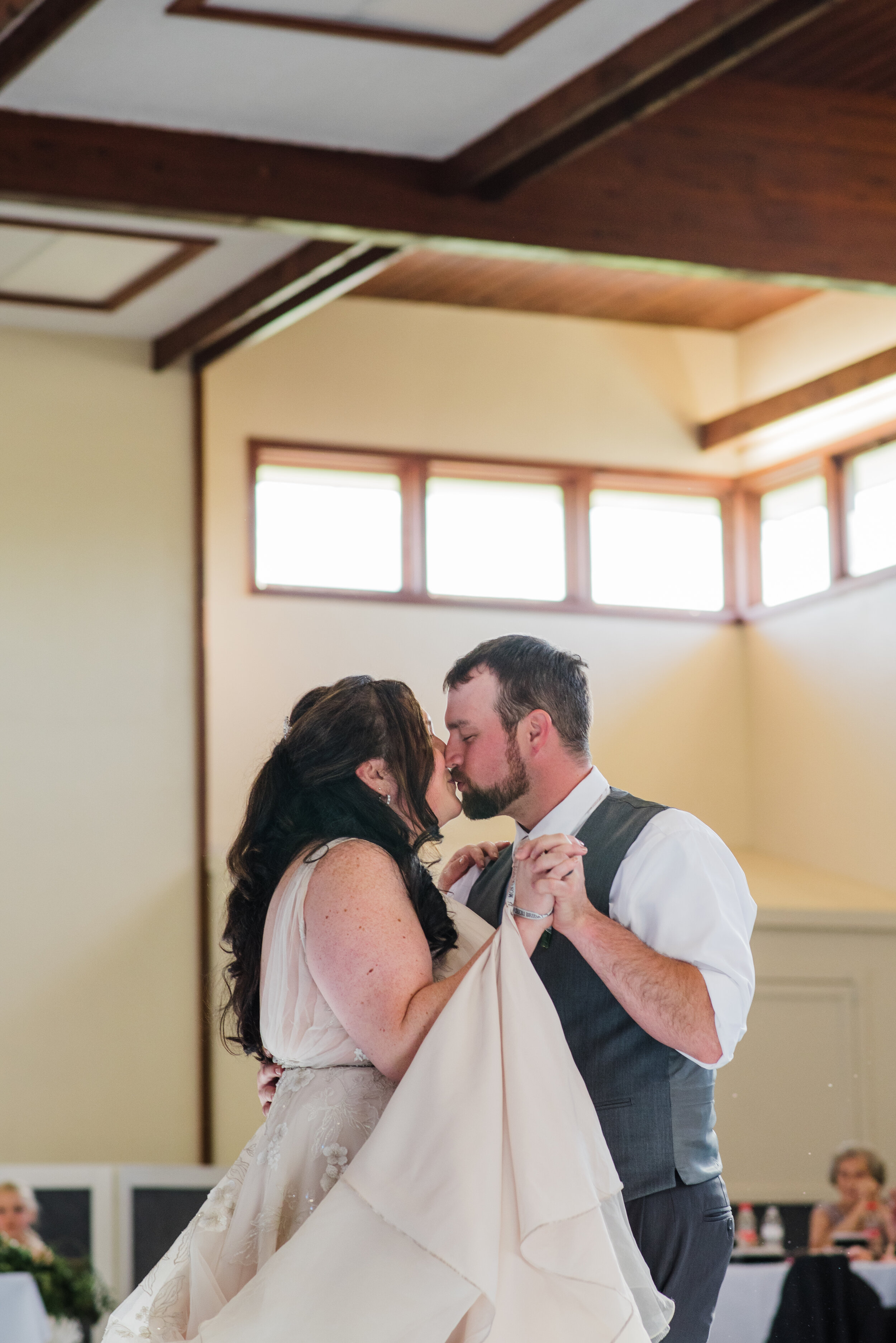 Wedding couple kissing during their first dance.