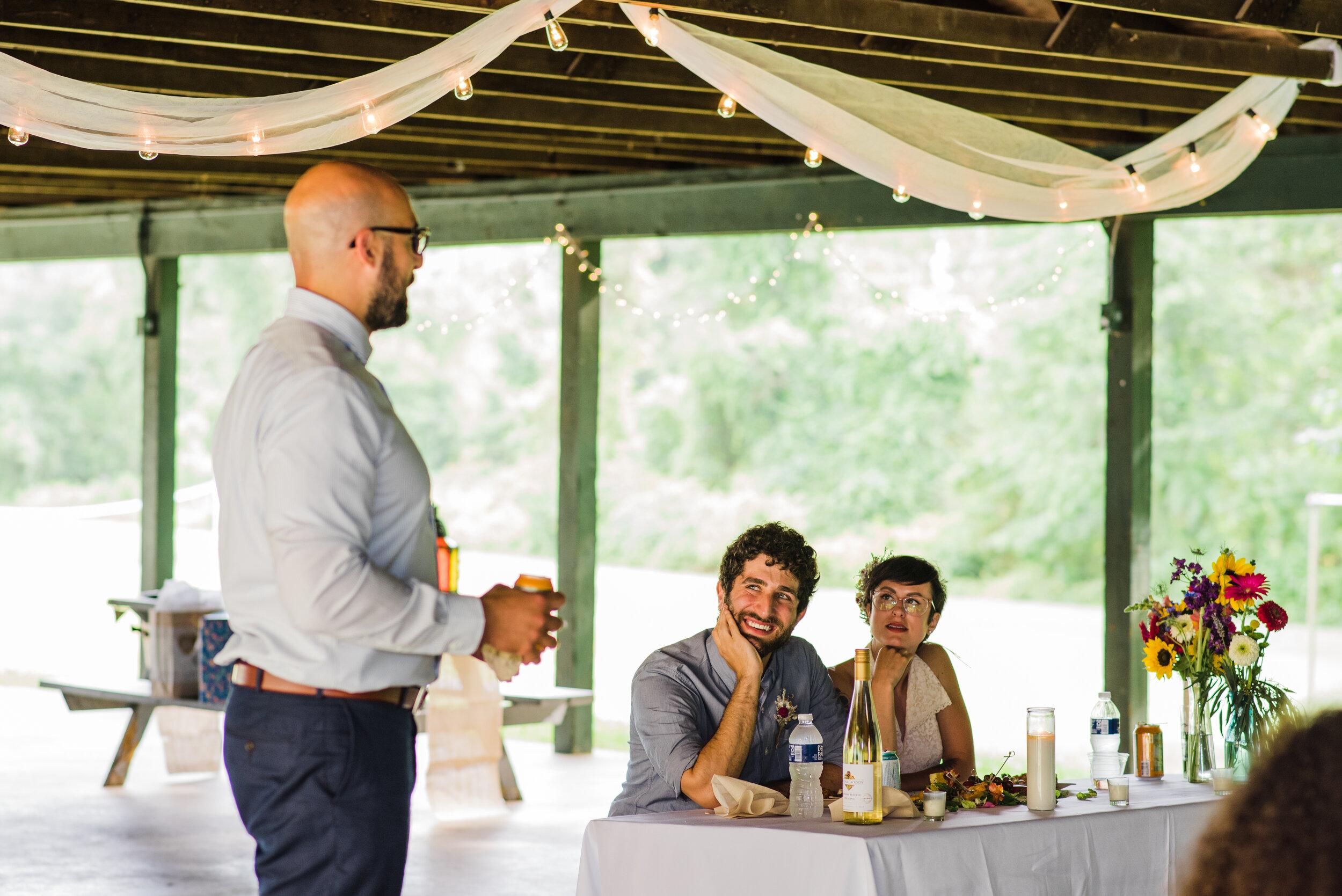 Couple's reaction during wedding speeches.