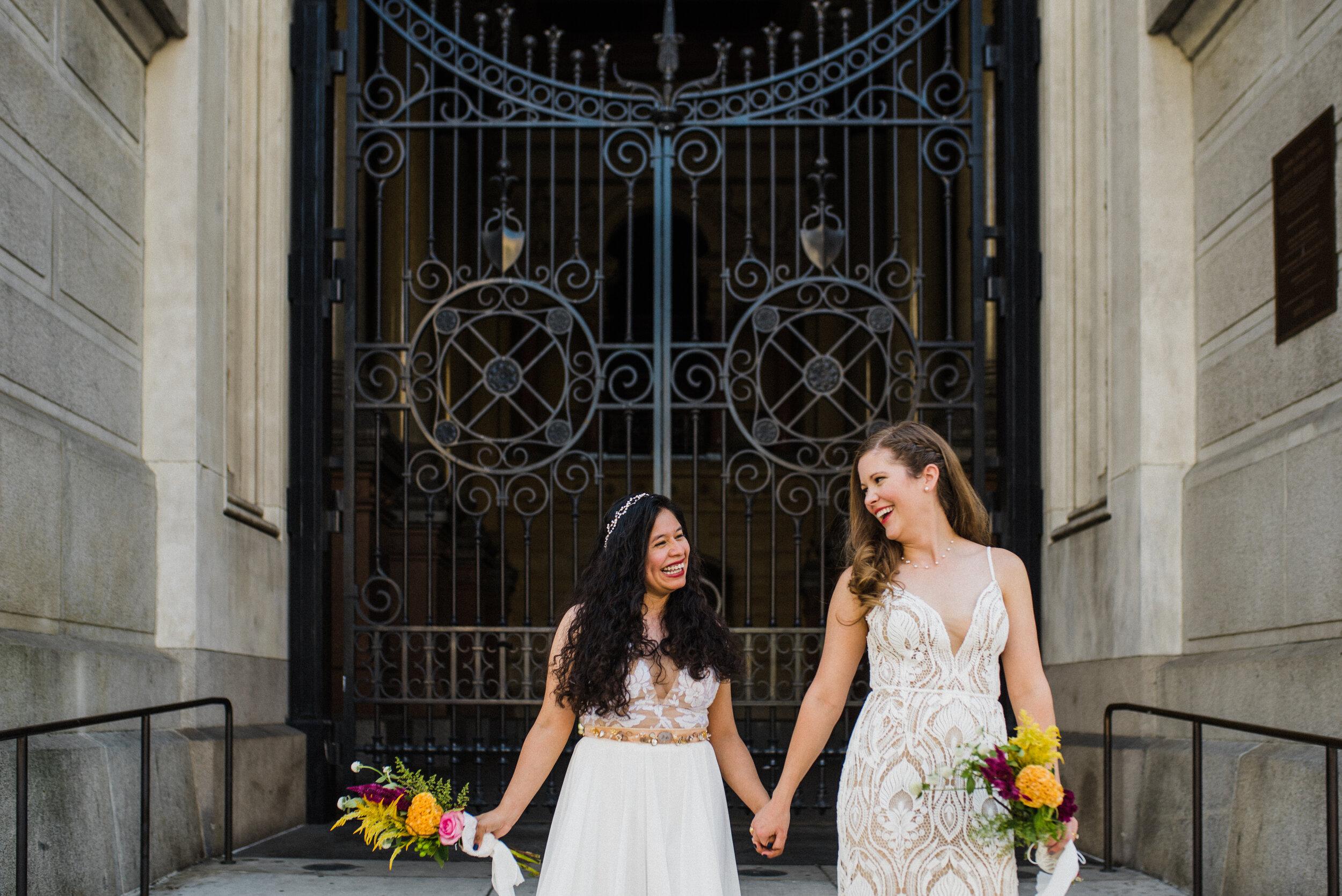 LGBTQ wedding couple walking around City Hall in Philadelphia