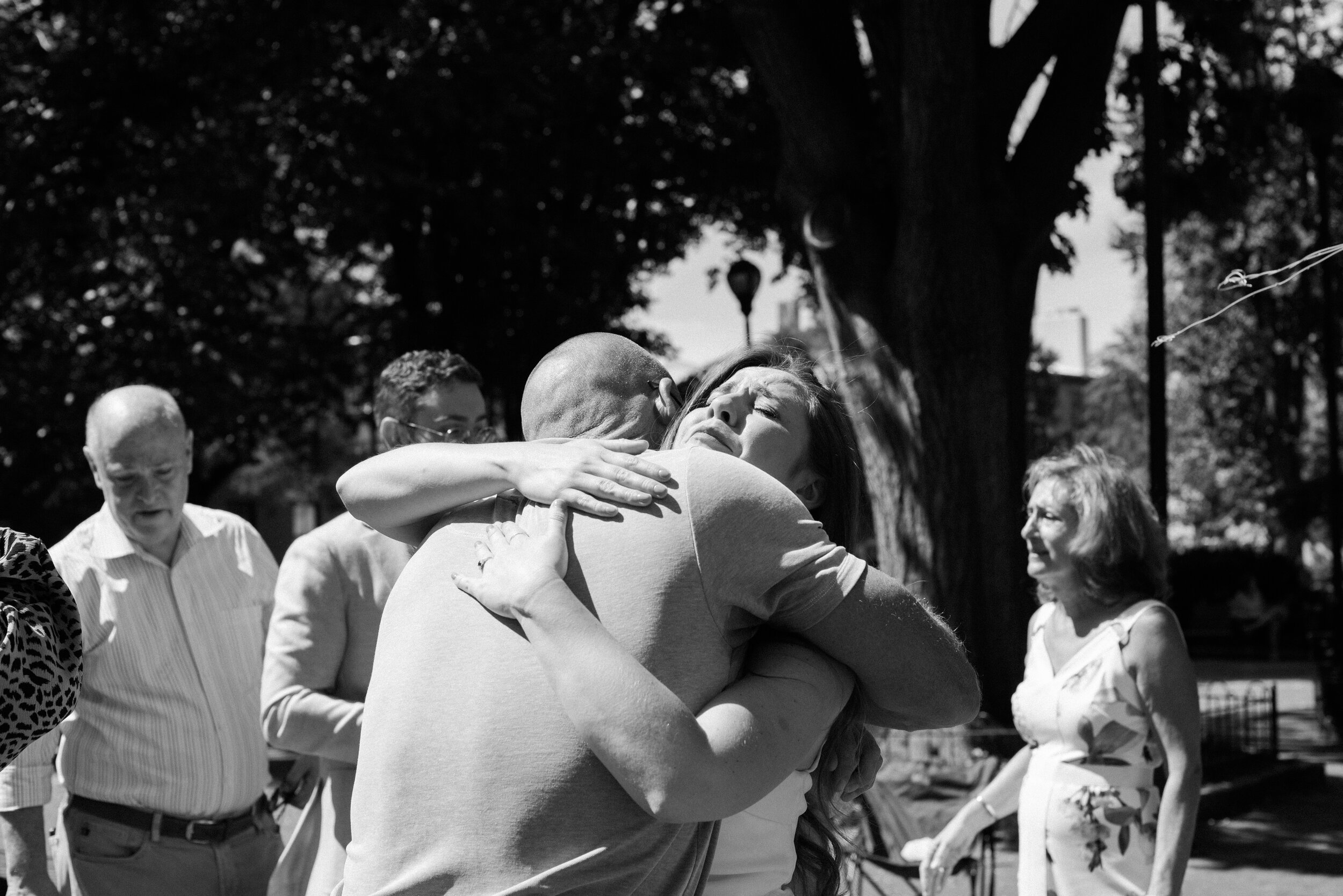 Father and daughter embracing after the ceremony.