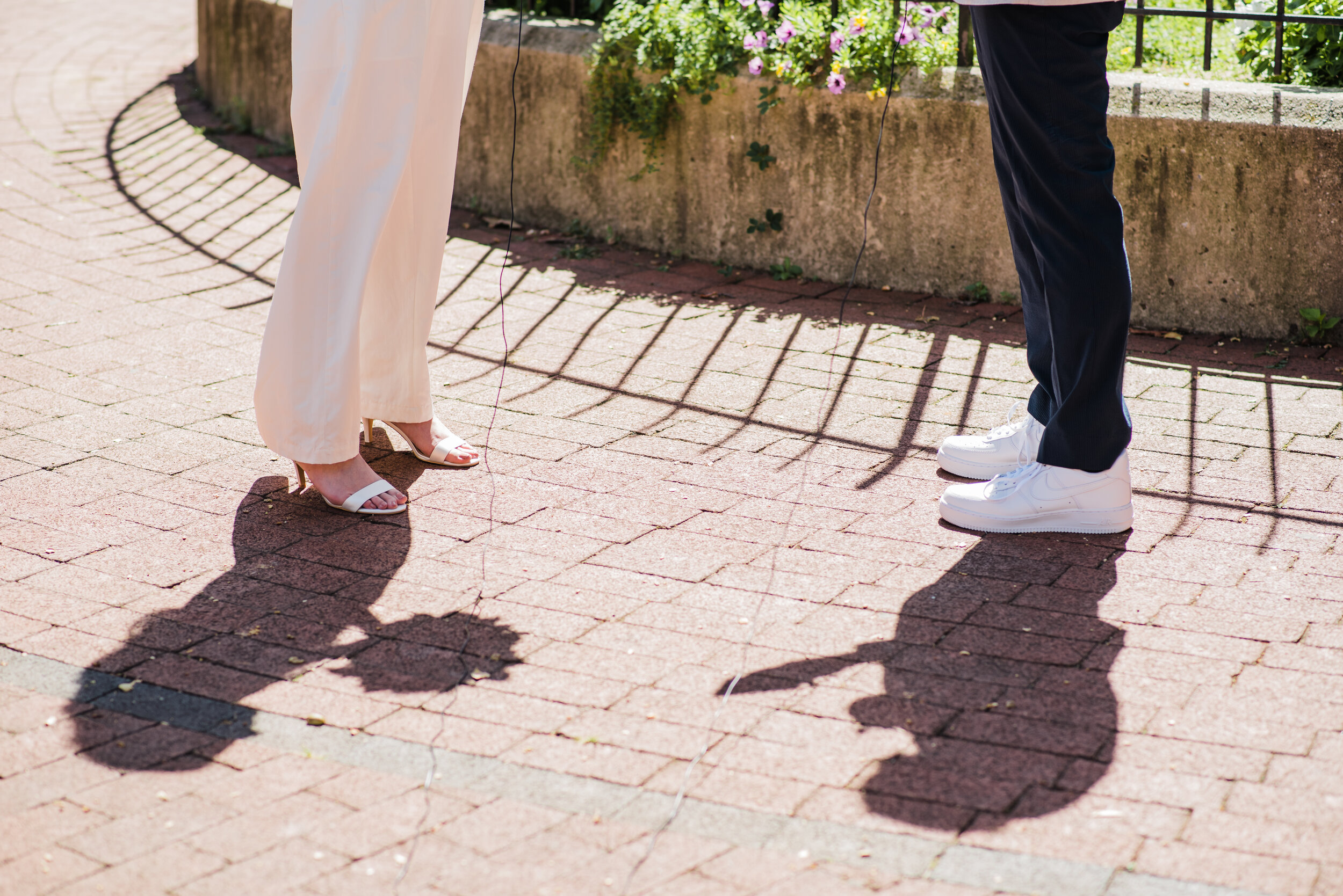 Shadows of a wedding couple at their outdoor elopement.