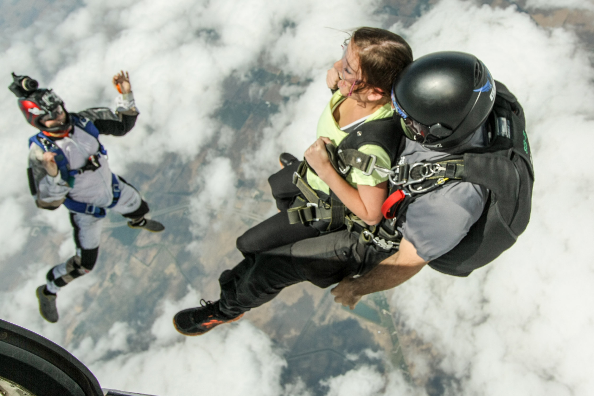 Skydive videographer captures exit.