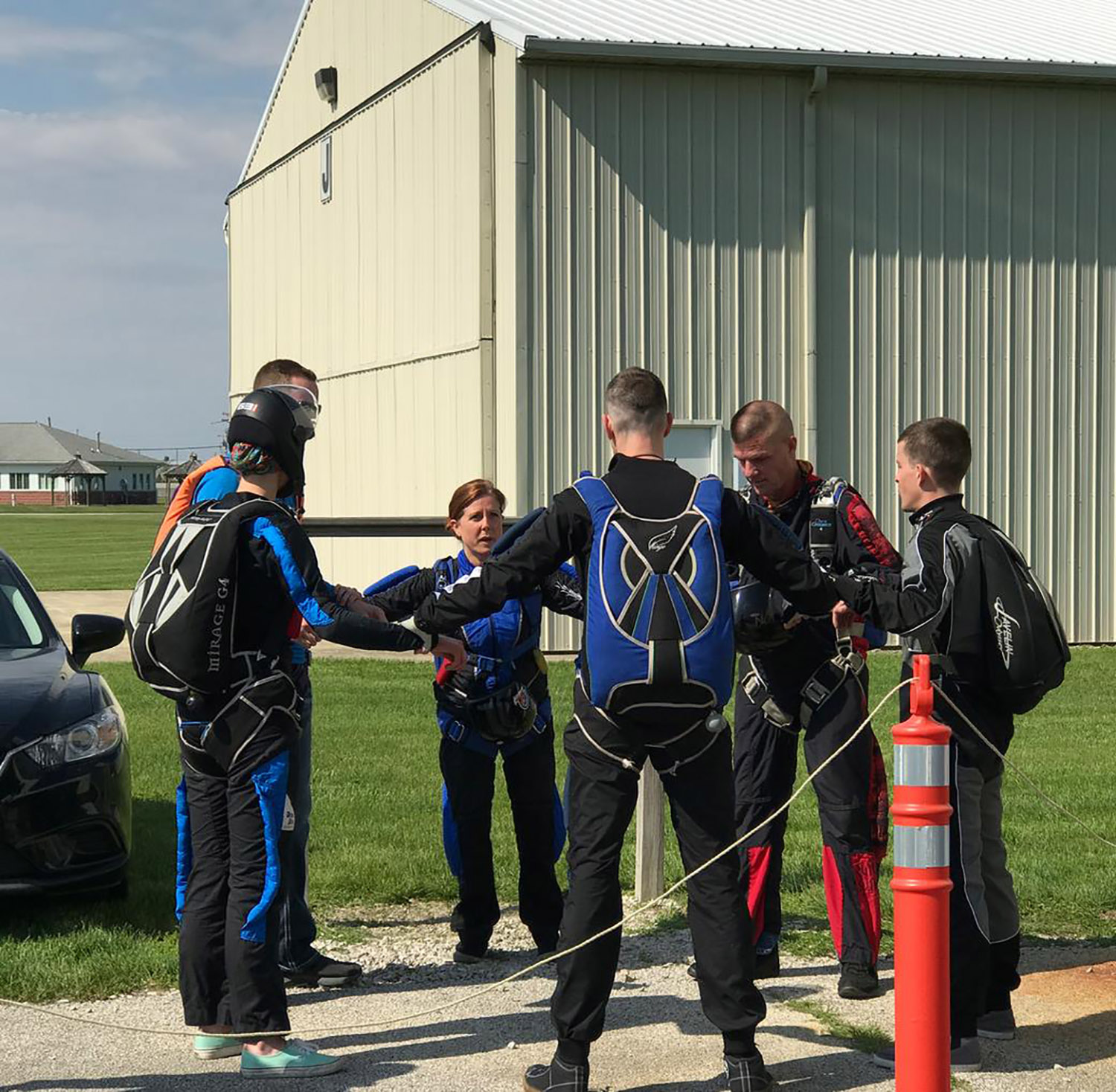 Experienced skydivers practice
