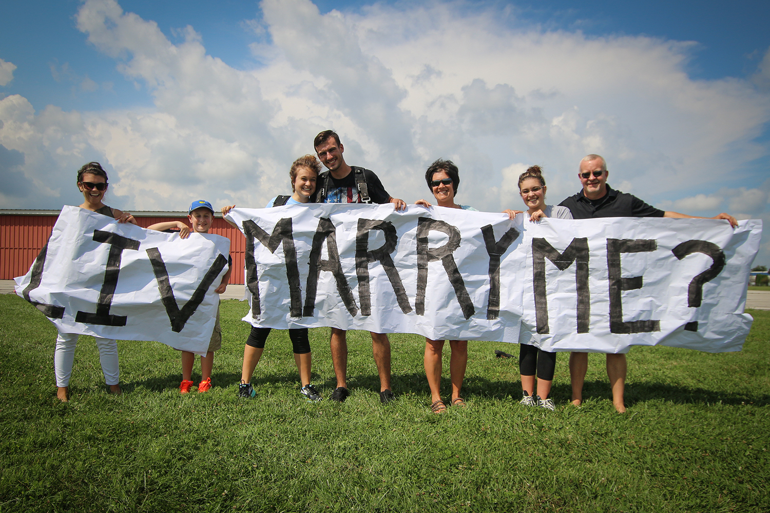 Friends and family at skydive proposal