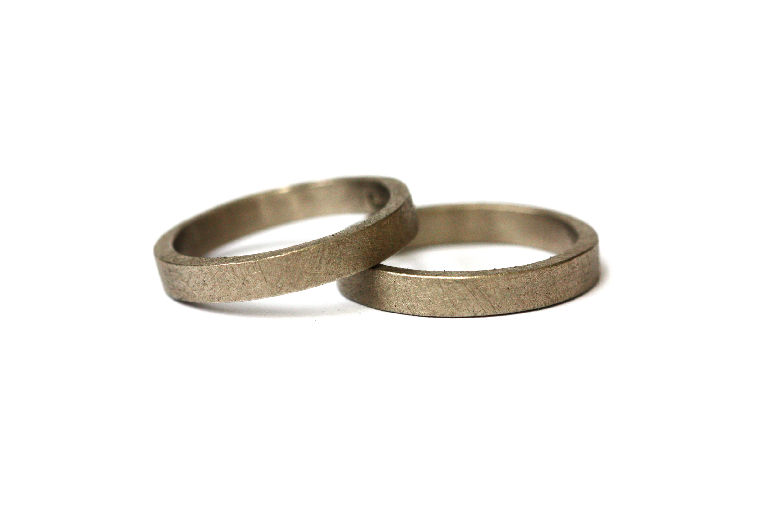 Wedding Rings  Made of 18ct white gold these rings have a dark grey tone giving a cooler tone of gold and an alternative to platinum or palladium.