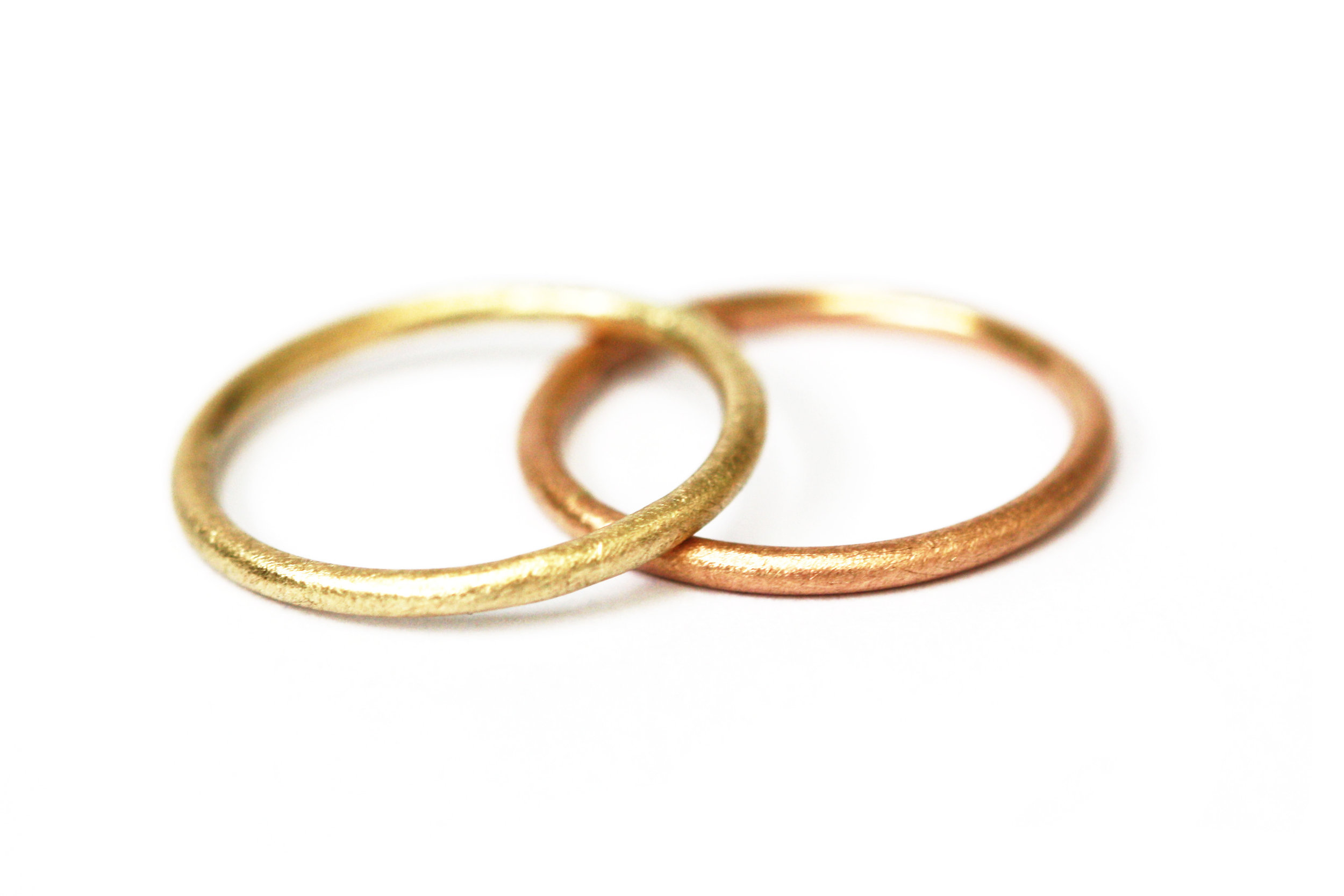 Round and Around  Simple, understated and classic, the round profile bands made of 9ct yellow gold and 9ct rose gold show the tones of warmth avaialble.
