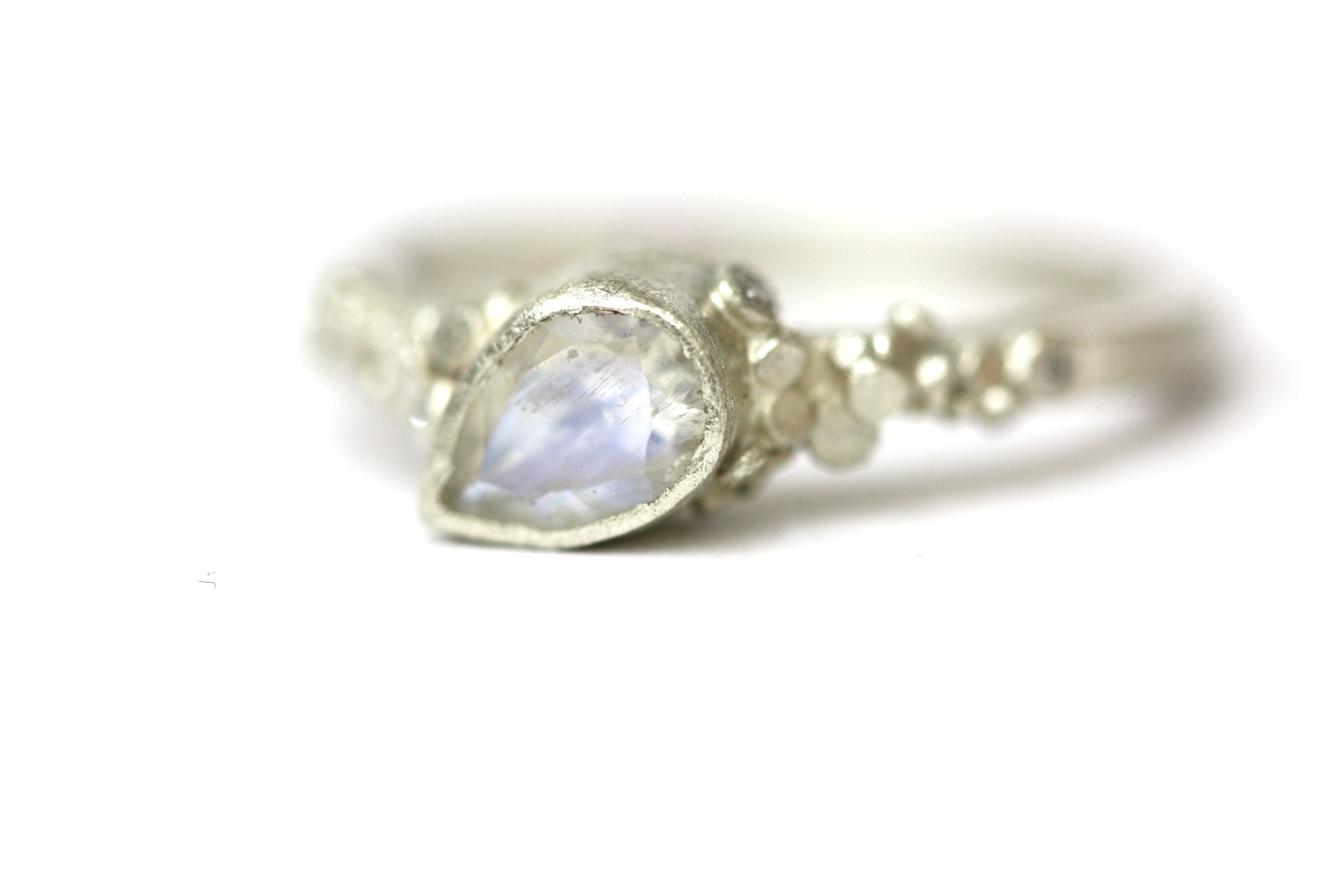 Moonstone Magic  This faceted moonstone is set in cool 9ct white gold. Set in our signature asymmetric style and speckles is a conversation starter.