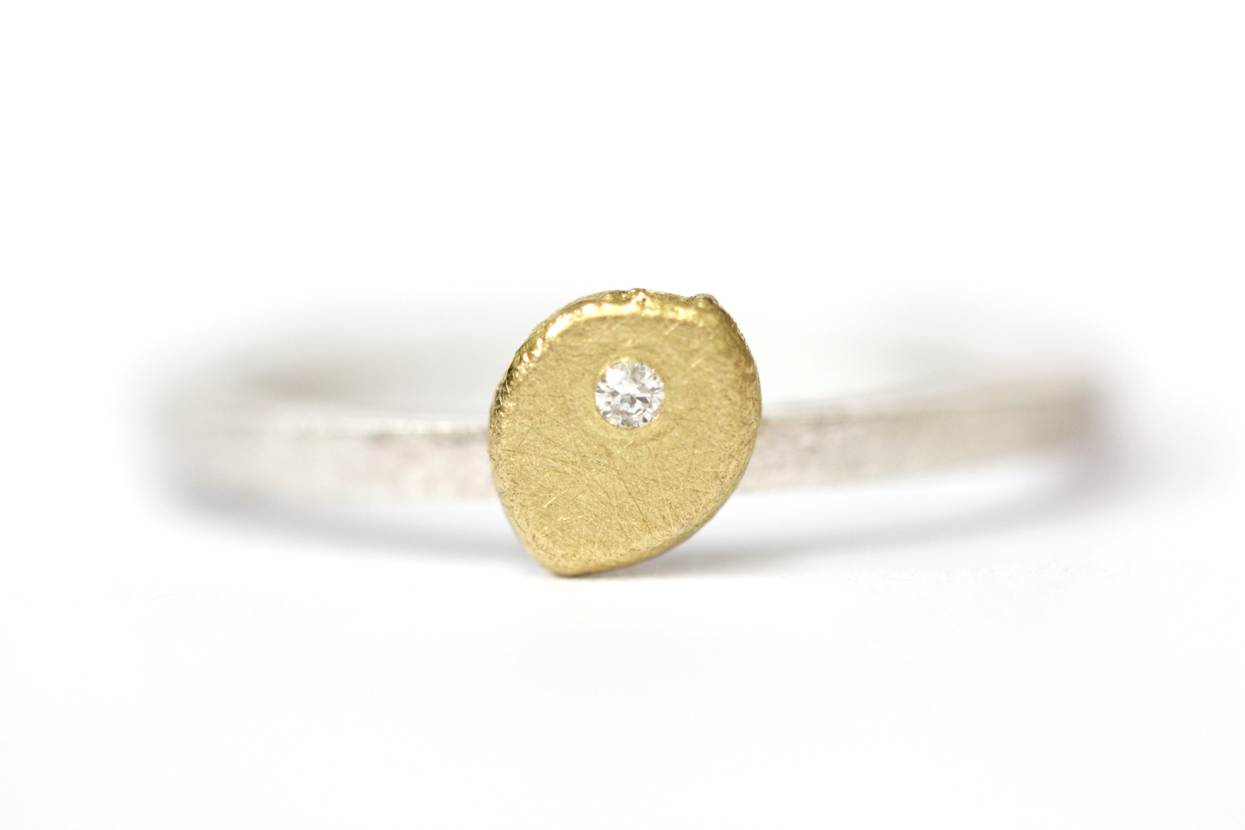 Simple Speckle  This alternative ring mixes 18ct yellow gold set with a diamond on a 9ct white gold ring. Each Speckle of metal is made by hand meaning no two are the same.