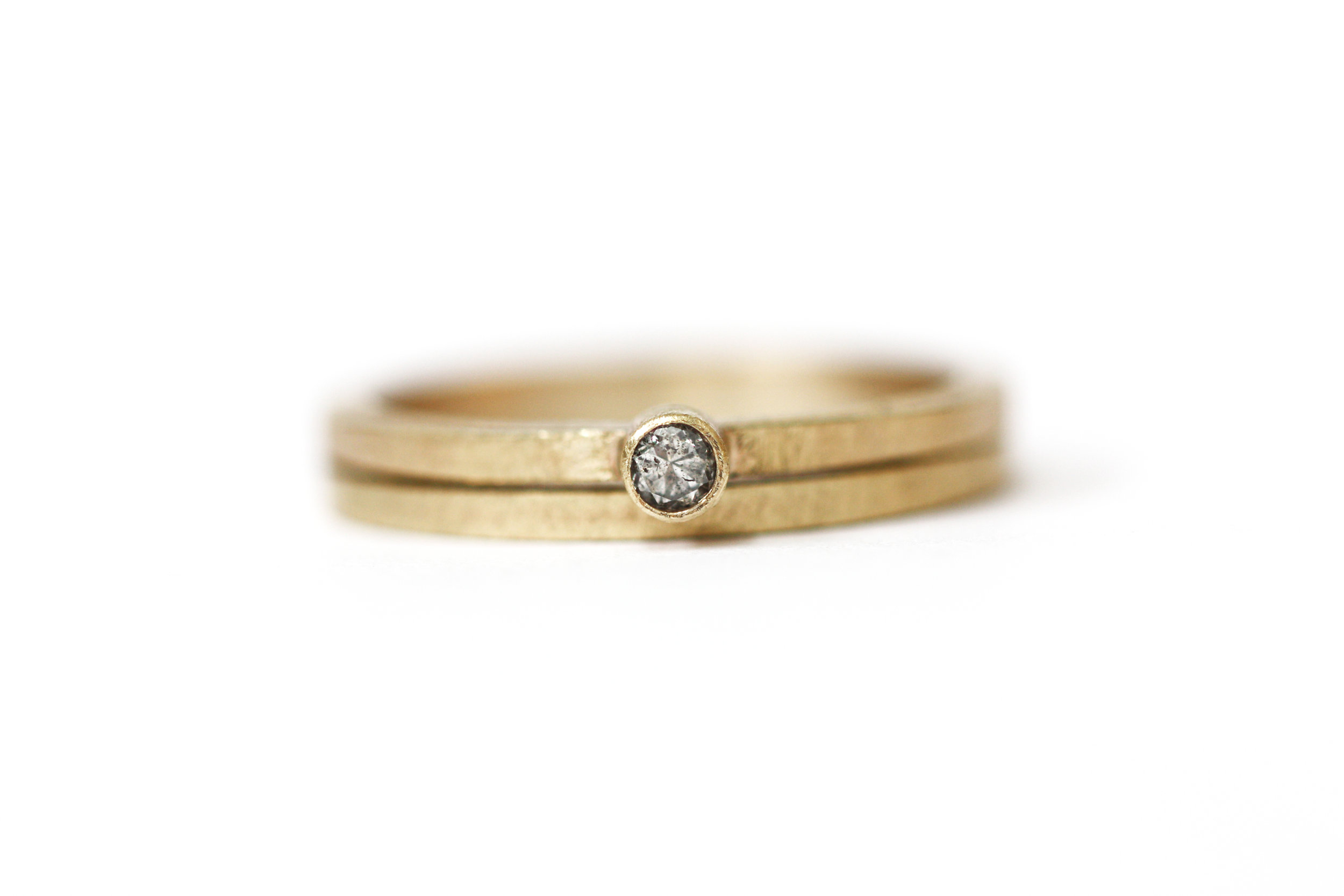Grey & Gold  Warm 9ct yellow gold and a grey diamond were used to create this ring set.