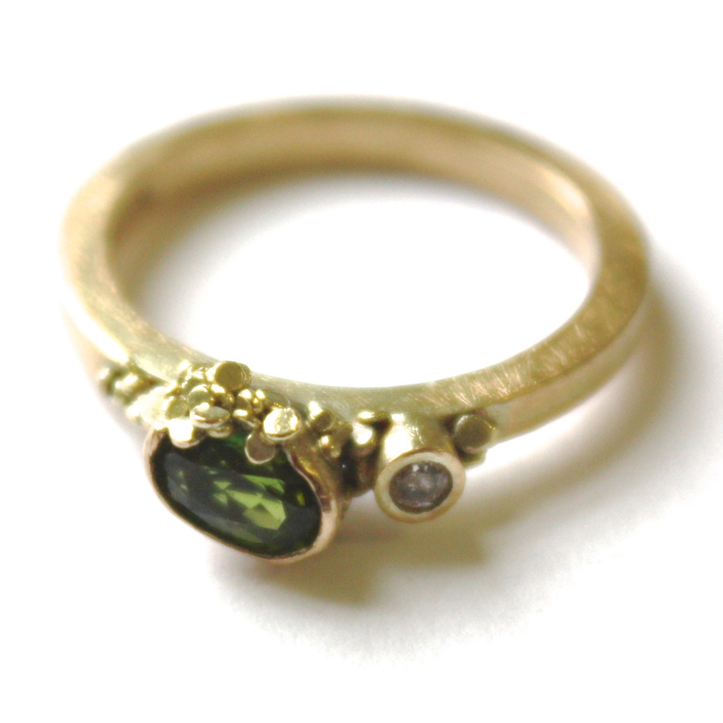 Speckle Ring  9ct yellow gold, green tourmaline and speckled grey diamond make this ring one of a kind. Sat asymmetric with clusters of speckles its unique.
