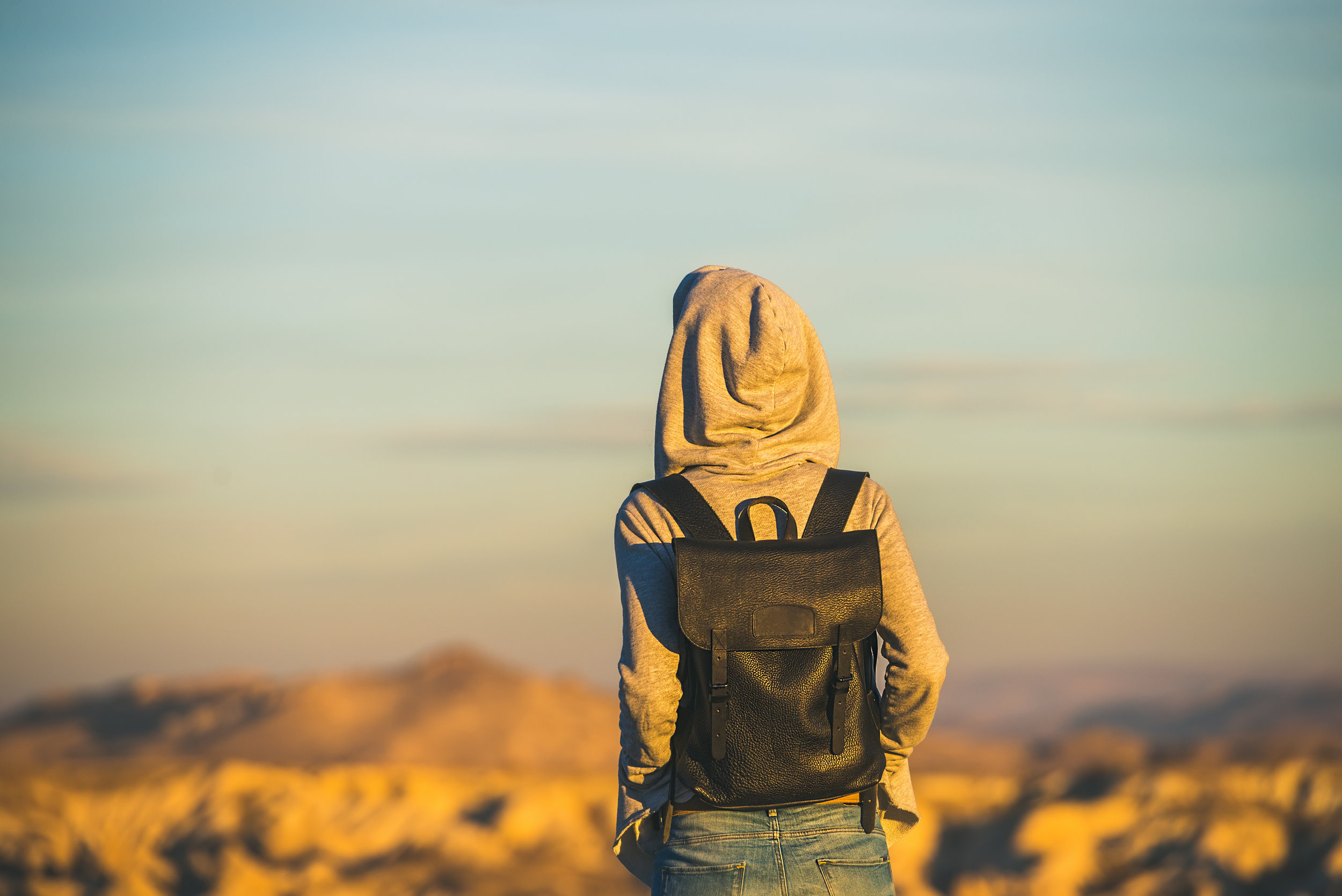 young-woman-traveller-watching-sunrise-in-goreme-PDZR4FU.jpg