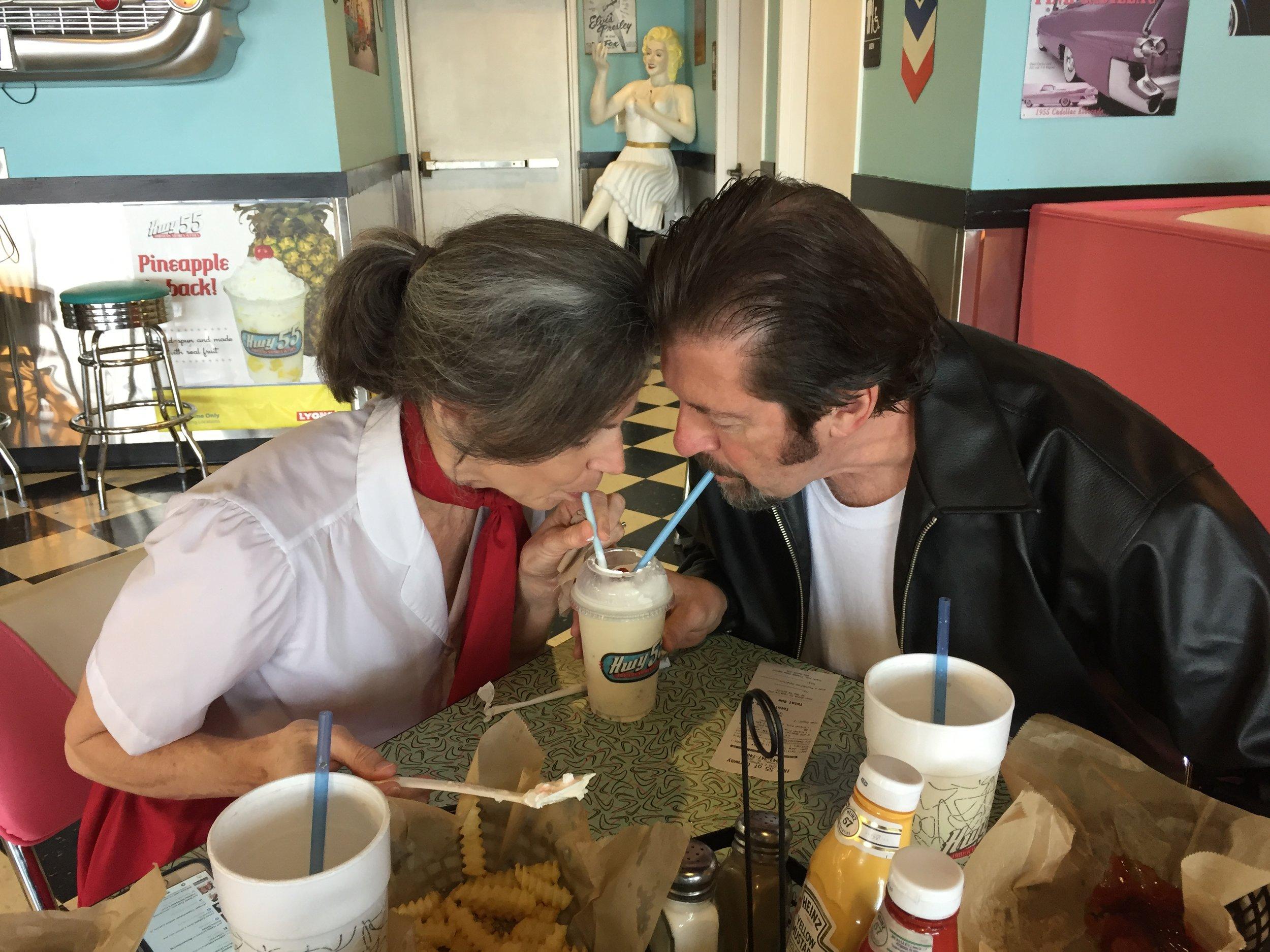 Kathy, Bill share milkshake.jpeg
