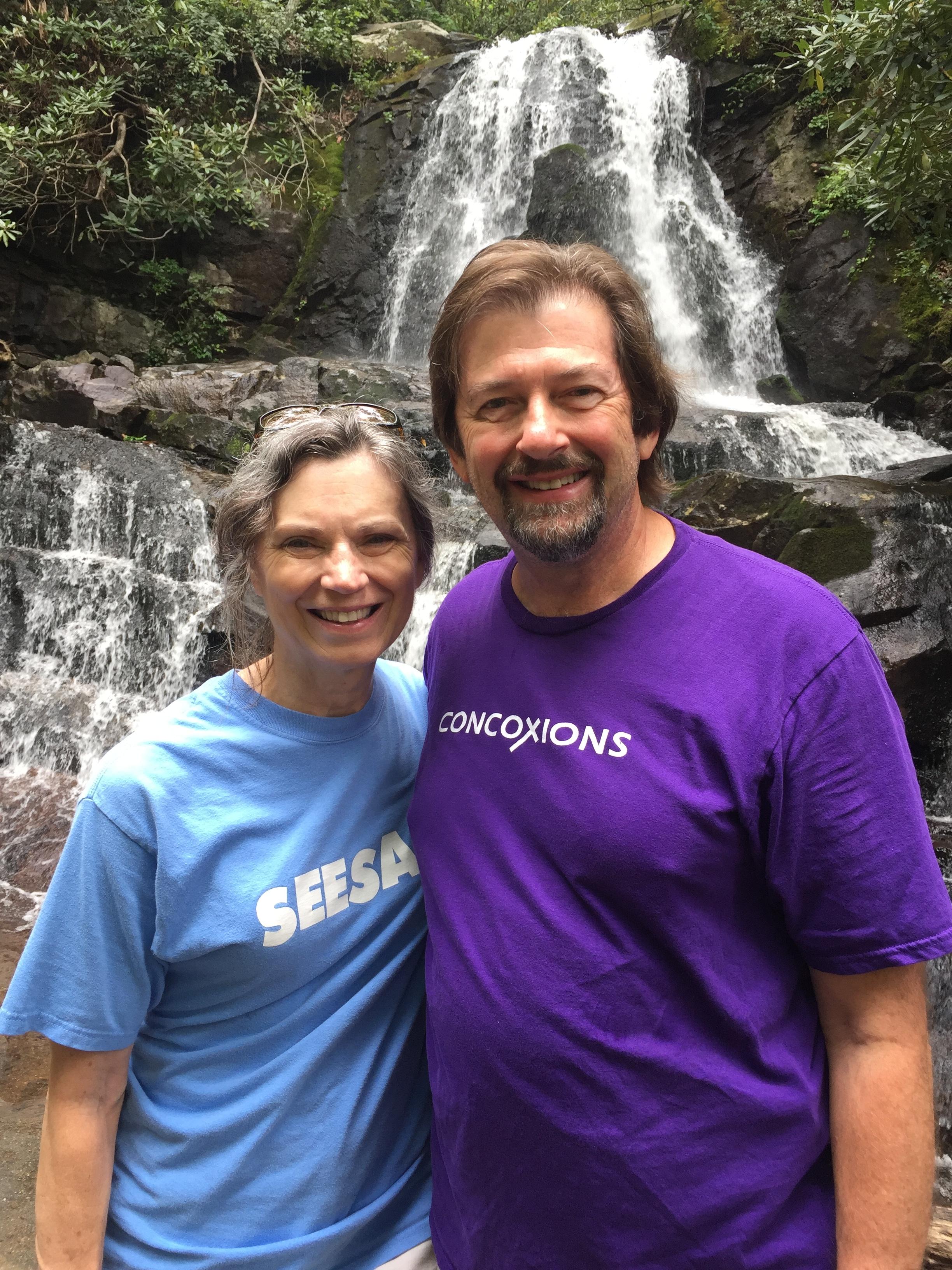 Kathy, Bill, waterfall.JPG