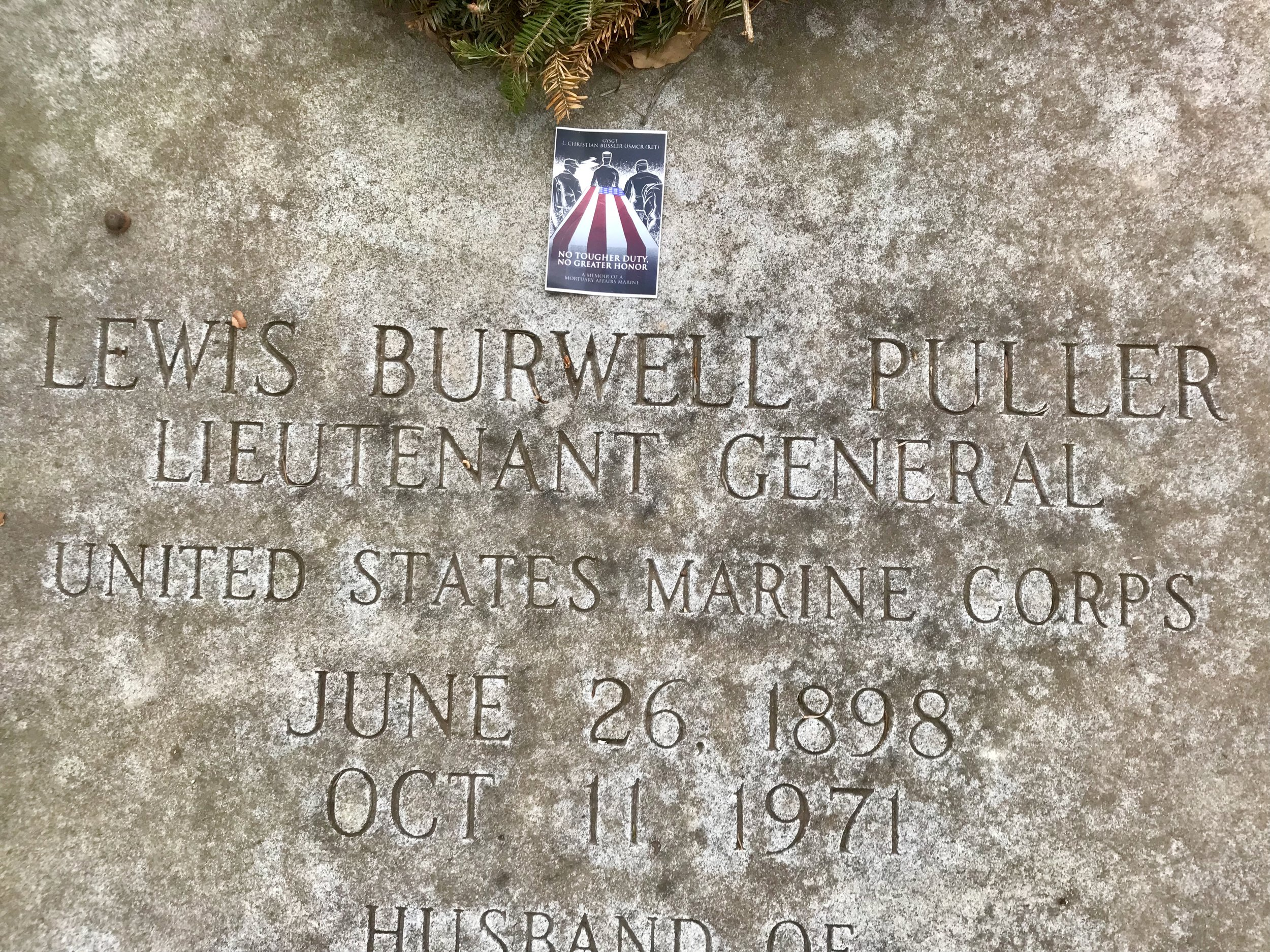 A sticker of the book at the gravesite of the most hardcore Marine in history, LtGen Chesty Puller!!!