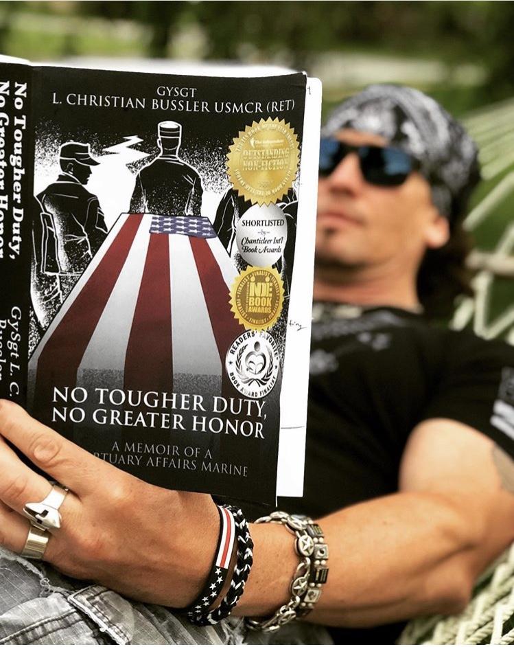 US Navy Veteran and patriotic rock star, Dave Bray USA reading a copy of my book!!! www.davebrayusa.com