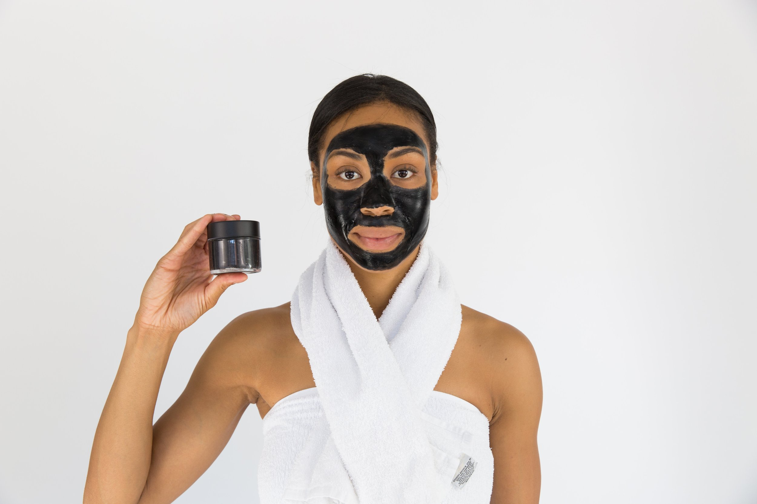 A woman with a facial mask on