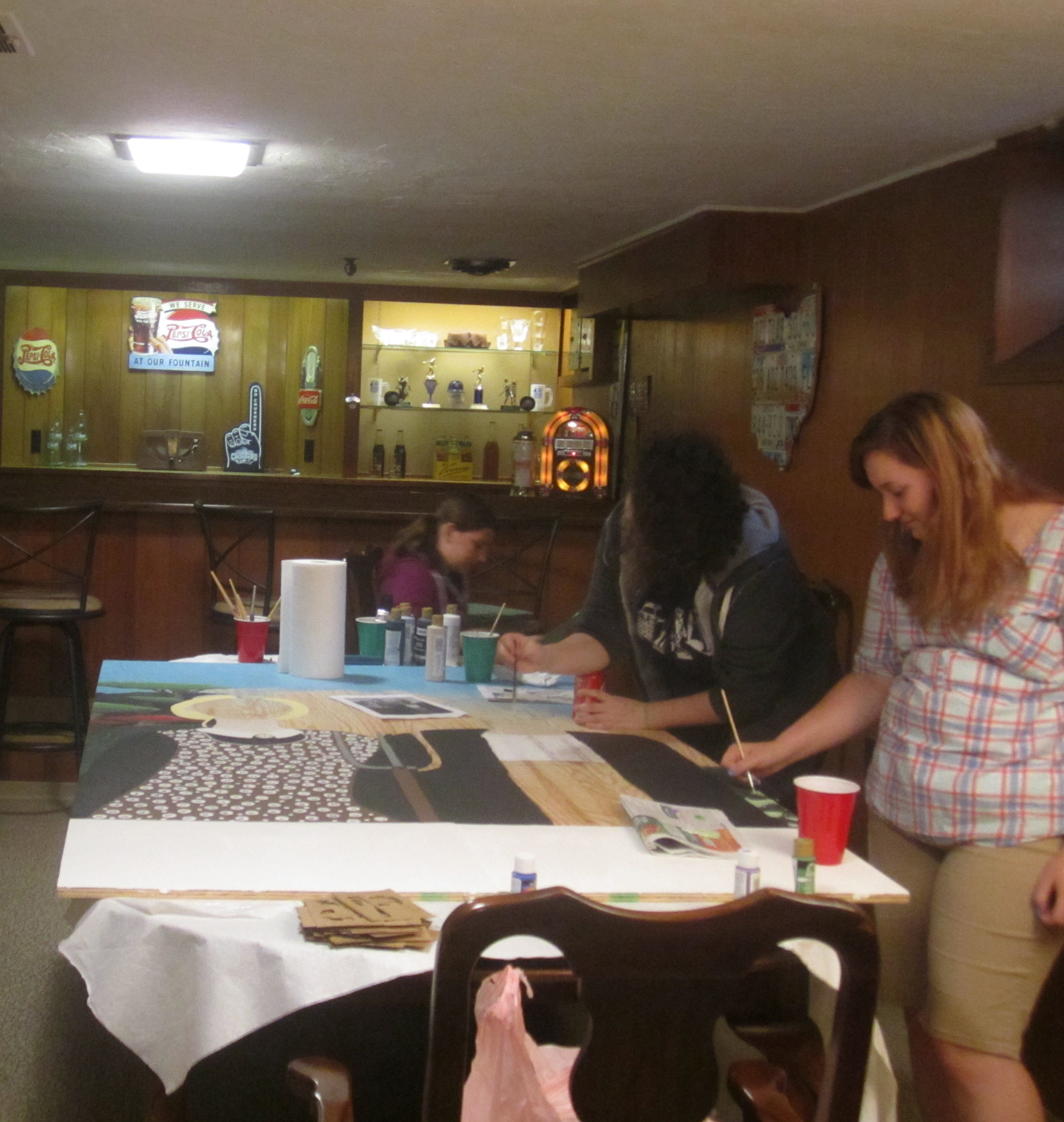 Carolyn Bedell, Sarah Drago and Allie Routhier working on Lilly Weston Cut-out Board for Fall Festival.JPG
