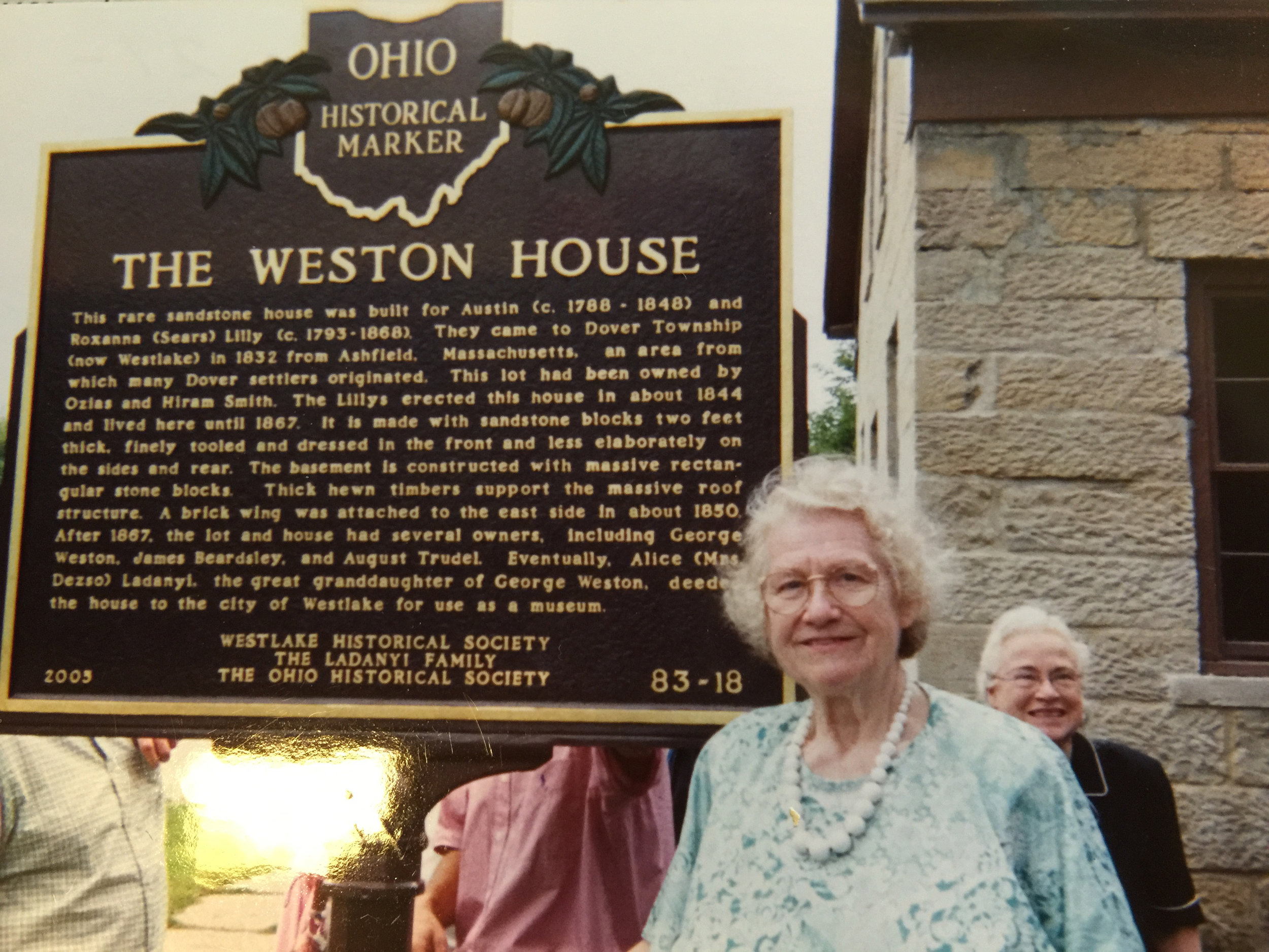 Doris Weston at the dedication of the Historical Marker in 2005.  In the background is Alice Ladanyi, also a Weston descendant who donated the home to the City in 2000.