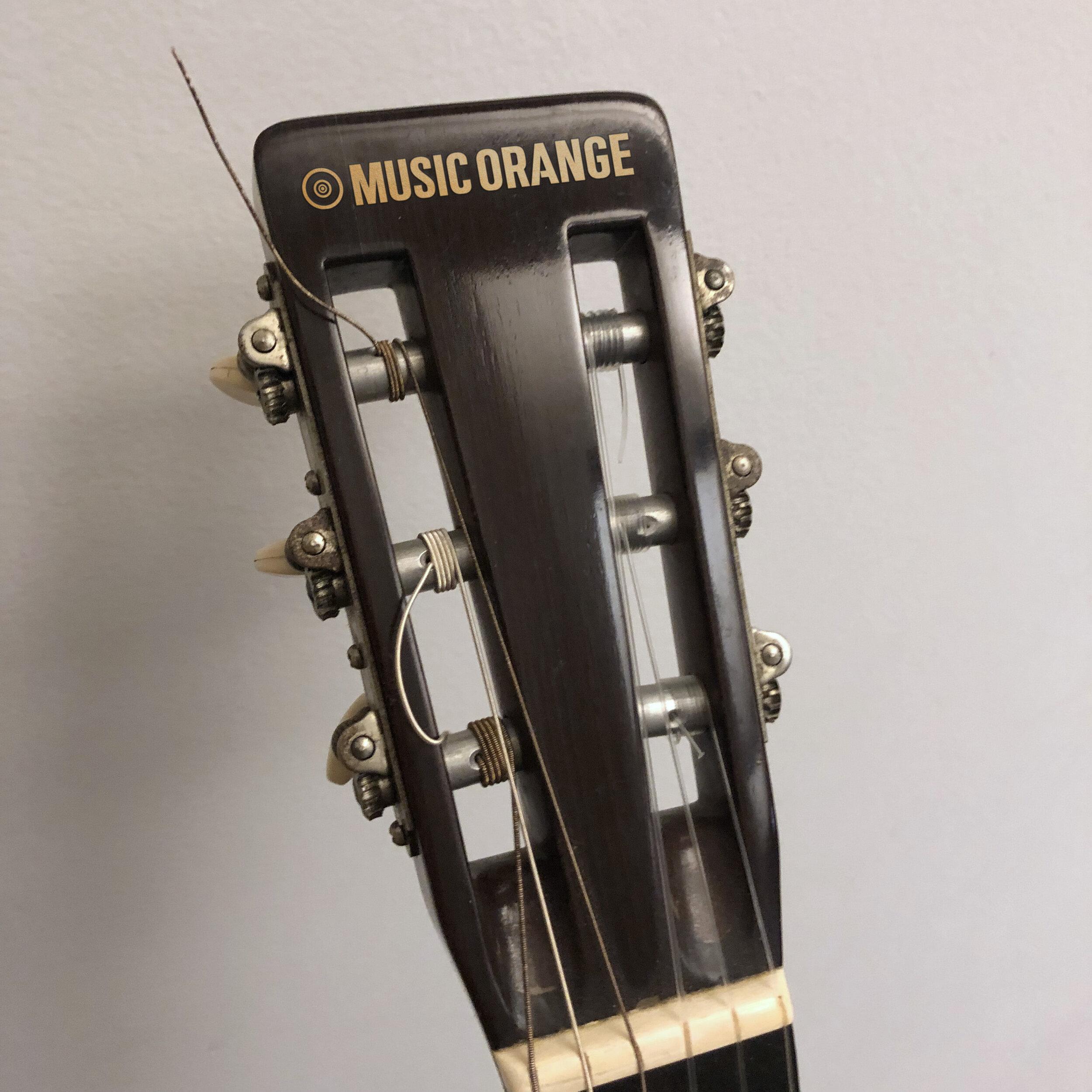 music-orange-guitar-headstock.jpg