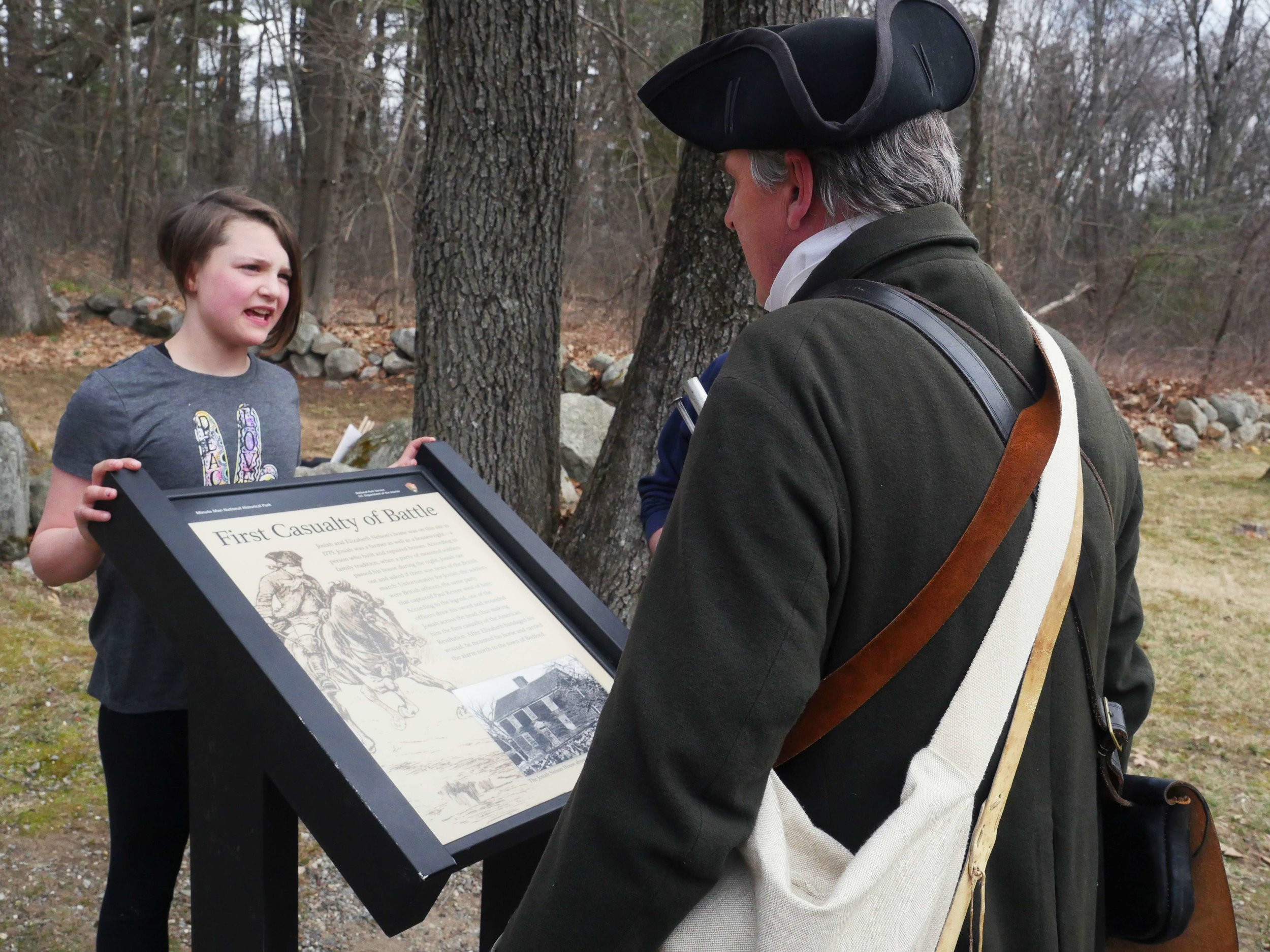 "Lincoln, MA - April 14th, 2018 - A young girl asks Battle of Lexington and Concord reenactor Hannes Klein questions about the Revolutionary War on his way to the battles. Klein loves the Revolutionary War because, ""I always say 'because of these guys with their sticks and their round balls we can have a free discussion, we can speak our minds and we're not being persecuted because of it' … and that to me is very important that they realized that."""