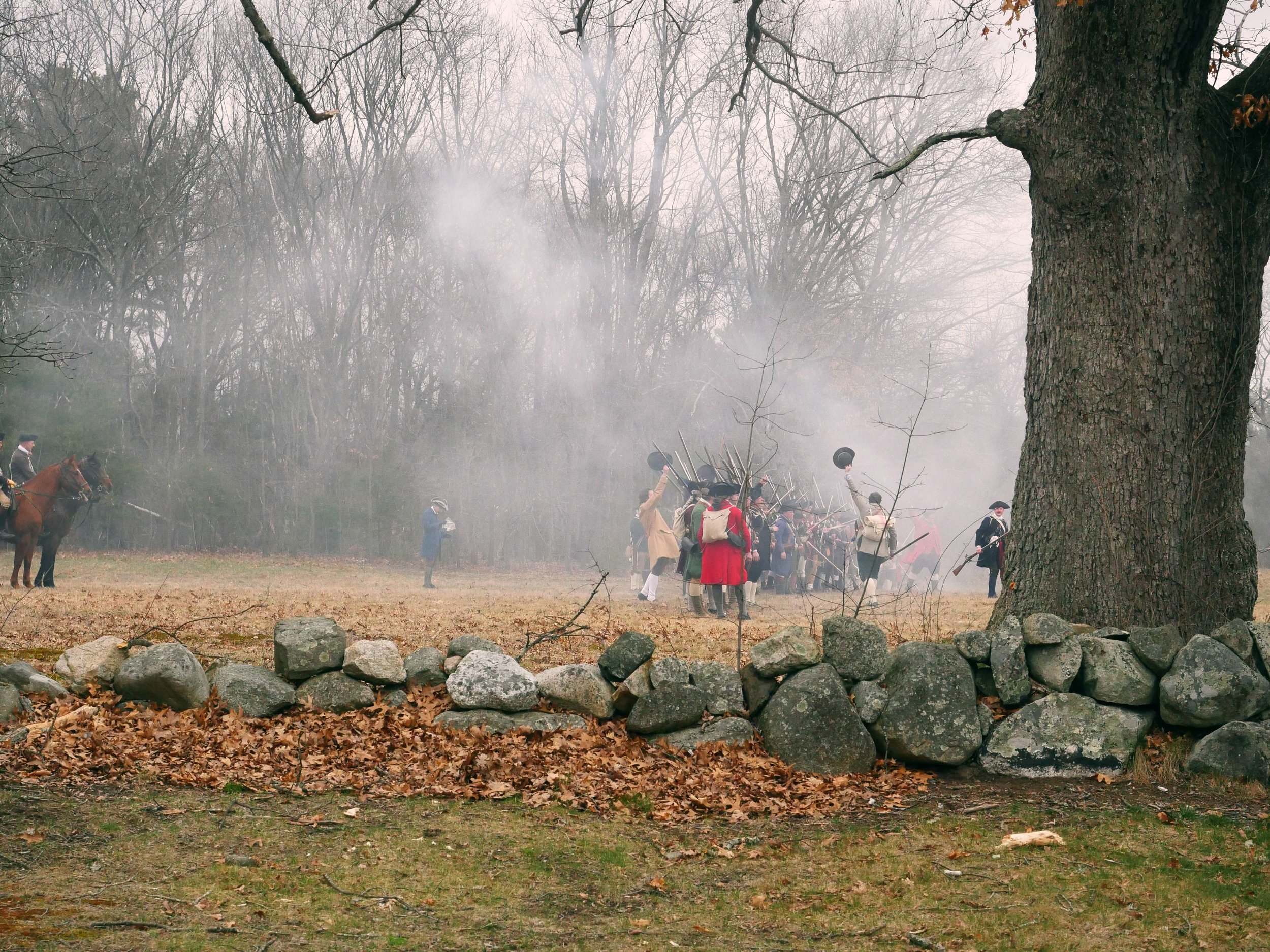"Lincoln, MA - April 14th, 2018 - Members of the militia celebrate after defeating the ""regulars"" in the Battles of Lexington and Concord. ""To me it's kind of interesting [because] they come out there to see us shoot our muskets, and that's pretty much the extent and they don't know anything that's past that, and that's our job to do that,"" said Hannes Klein."