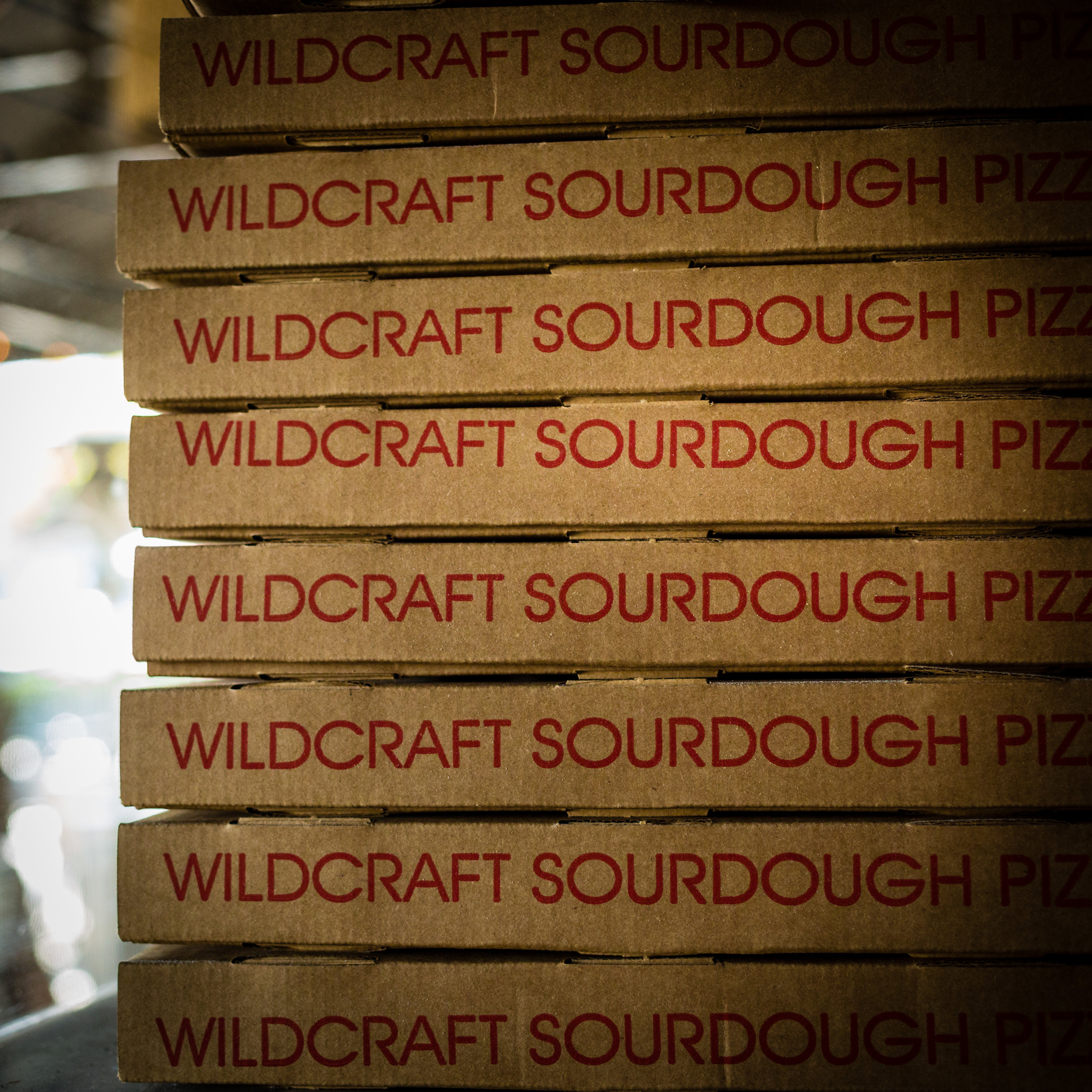 Stacked Wildcraft Pizza Boxes