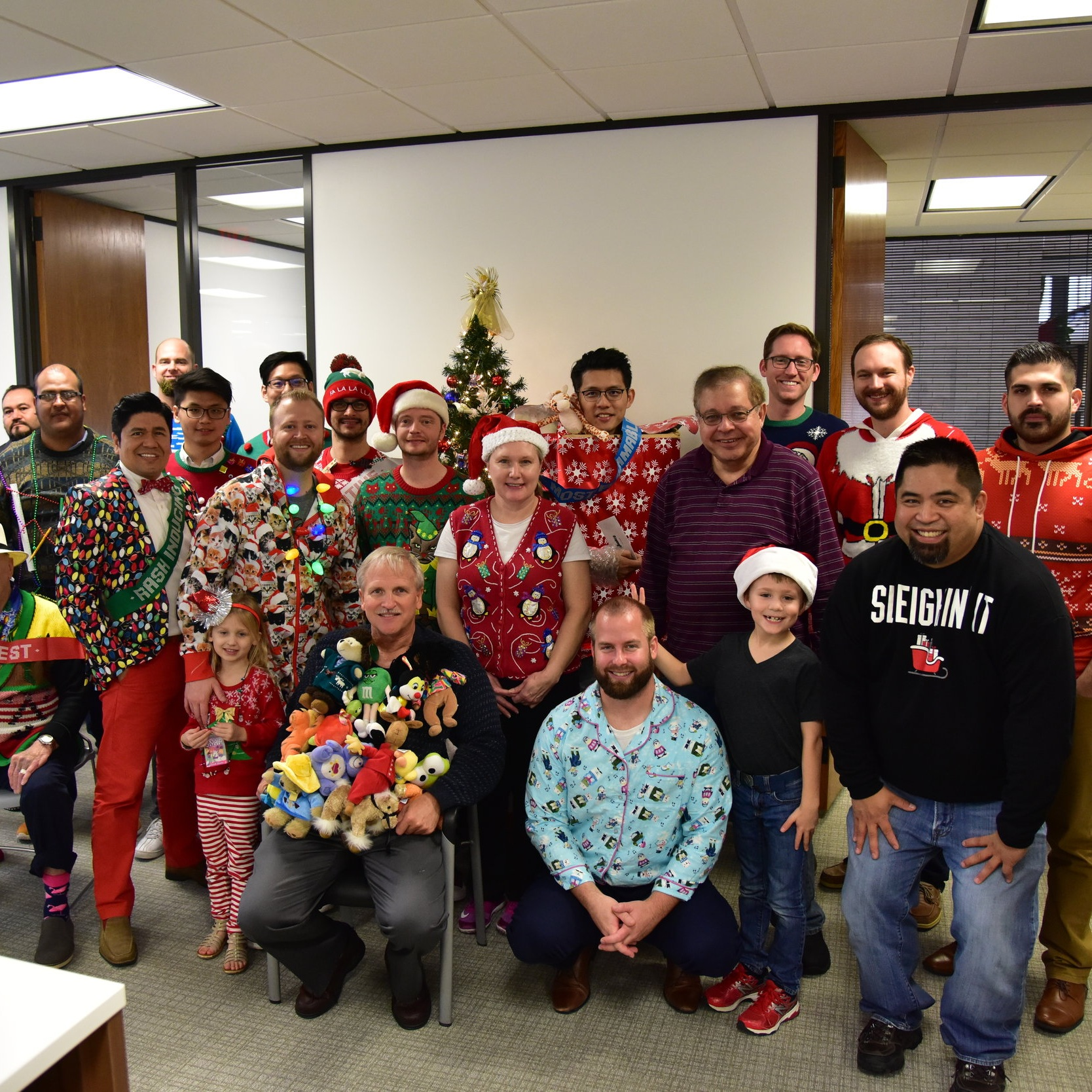 UGLY SWEATER CONTEST 2017 - Annual Ugly Sweater Contest is always a blast! The uglier and more creative the better. First place this year went to Leon who wrapped himself in a box as a gift!