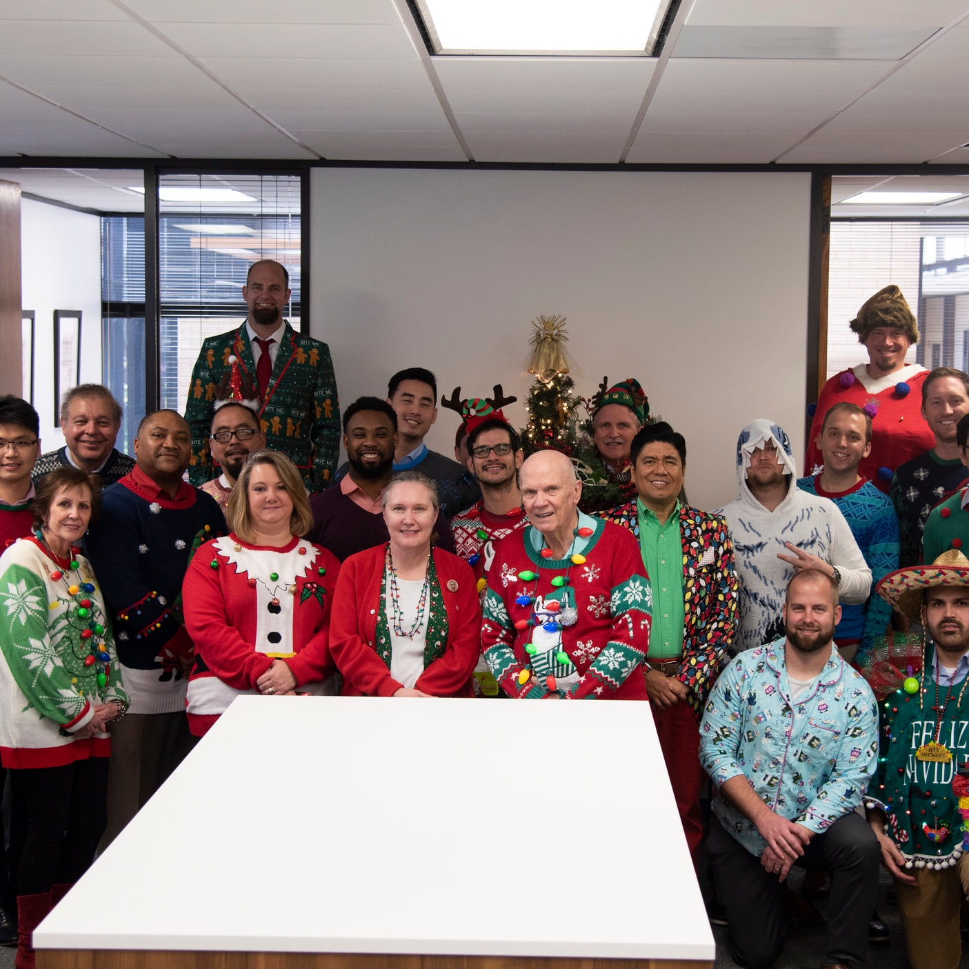 UGLY SWEATER CONTEST 2018 - Our annual ugly sweater/office Christmas party was great! The sweaters were ugly, the food was delicious, and the white elephant gifts brought some surprises.